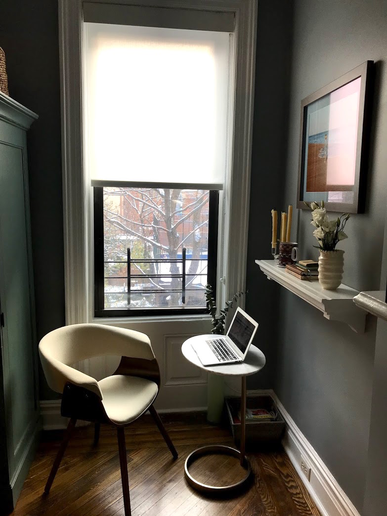 Reading nook after with side table and chair by window
