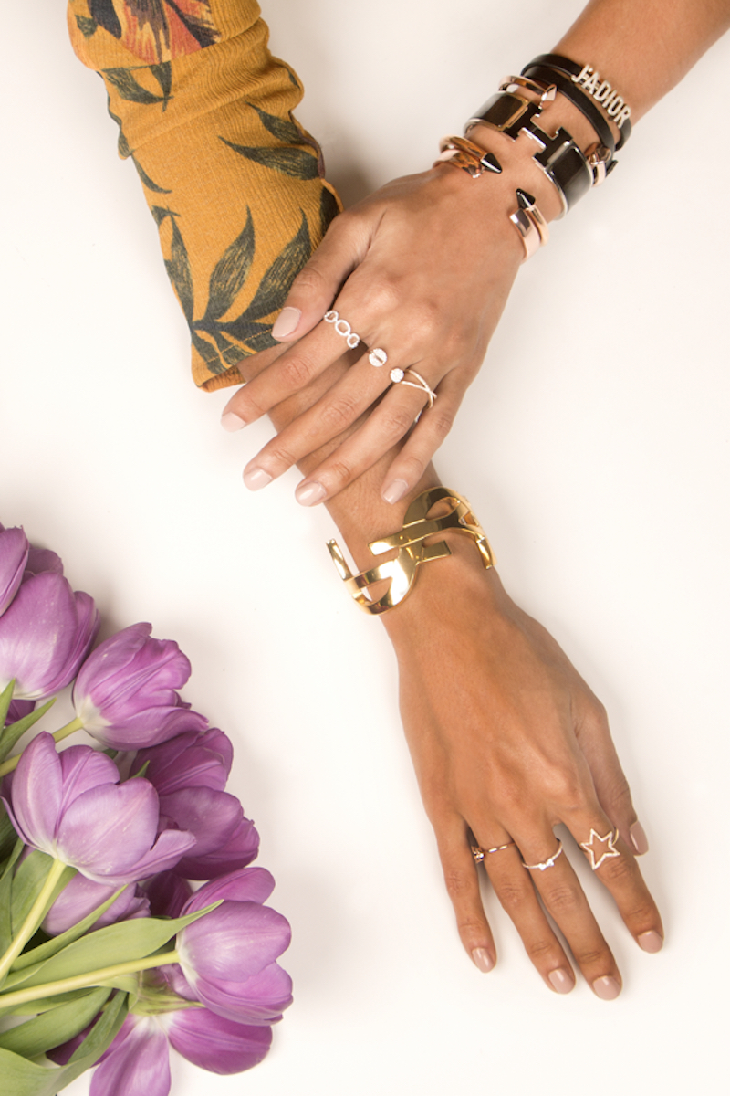 Rental jewelry company switch, hands covered in jewelry and rings