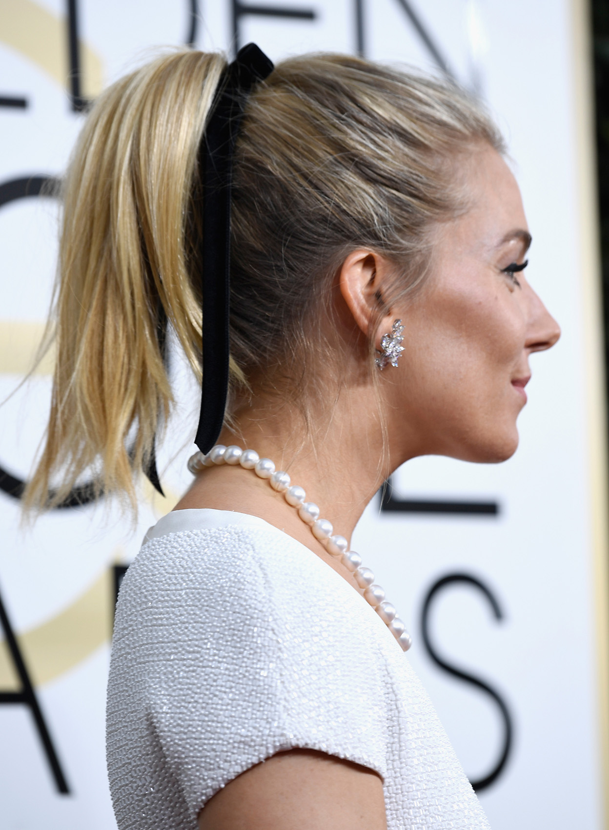 Sienna Miller at the 74th Annual Golden Globe Awards