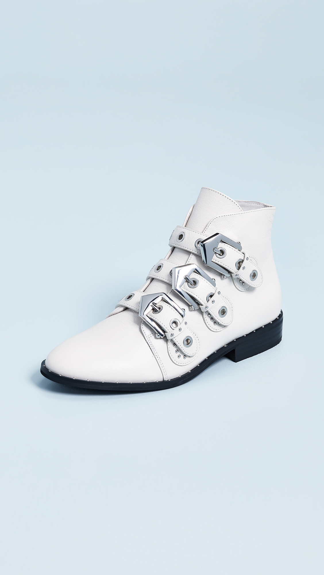 white ankle booties with buckles