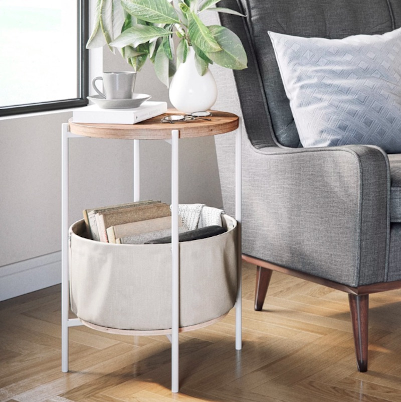white and wood side table with basket underneath