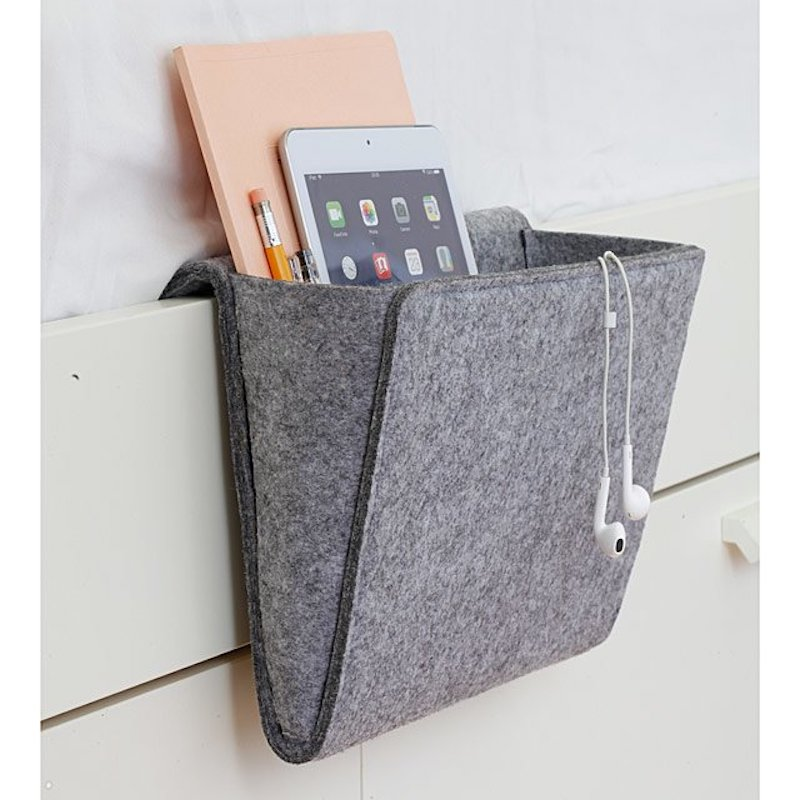 Gray felt pocket that hangs from side of bed