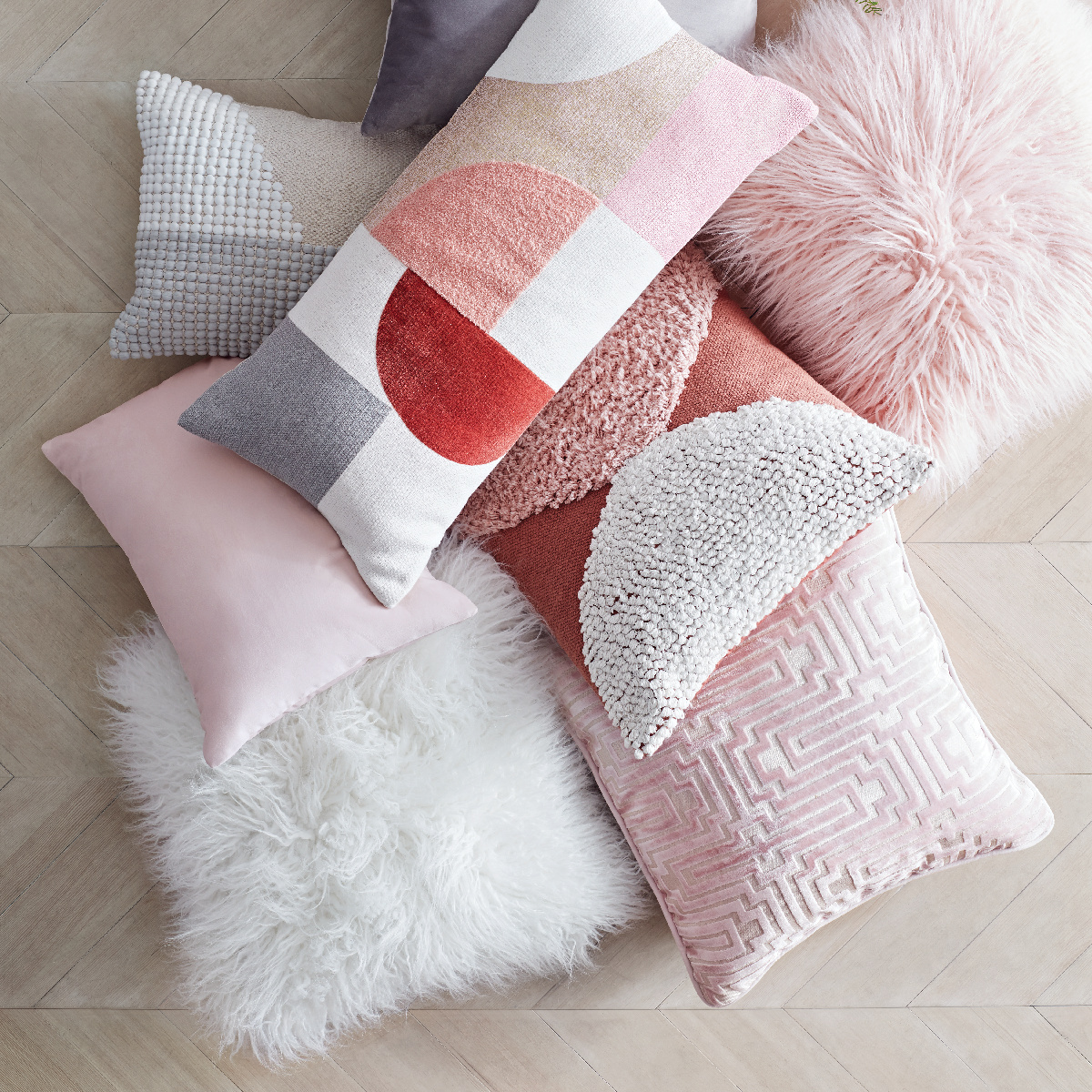 Pile of geometric and colorful pillows