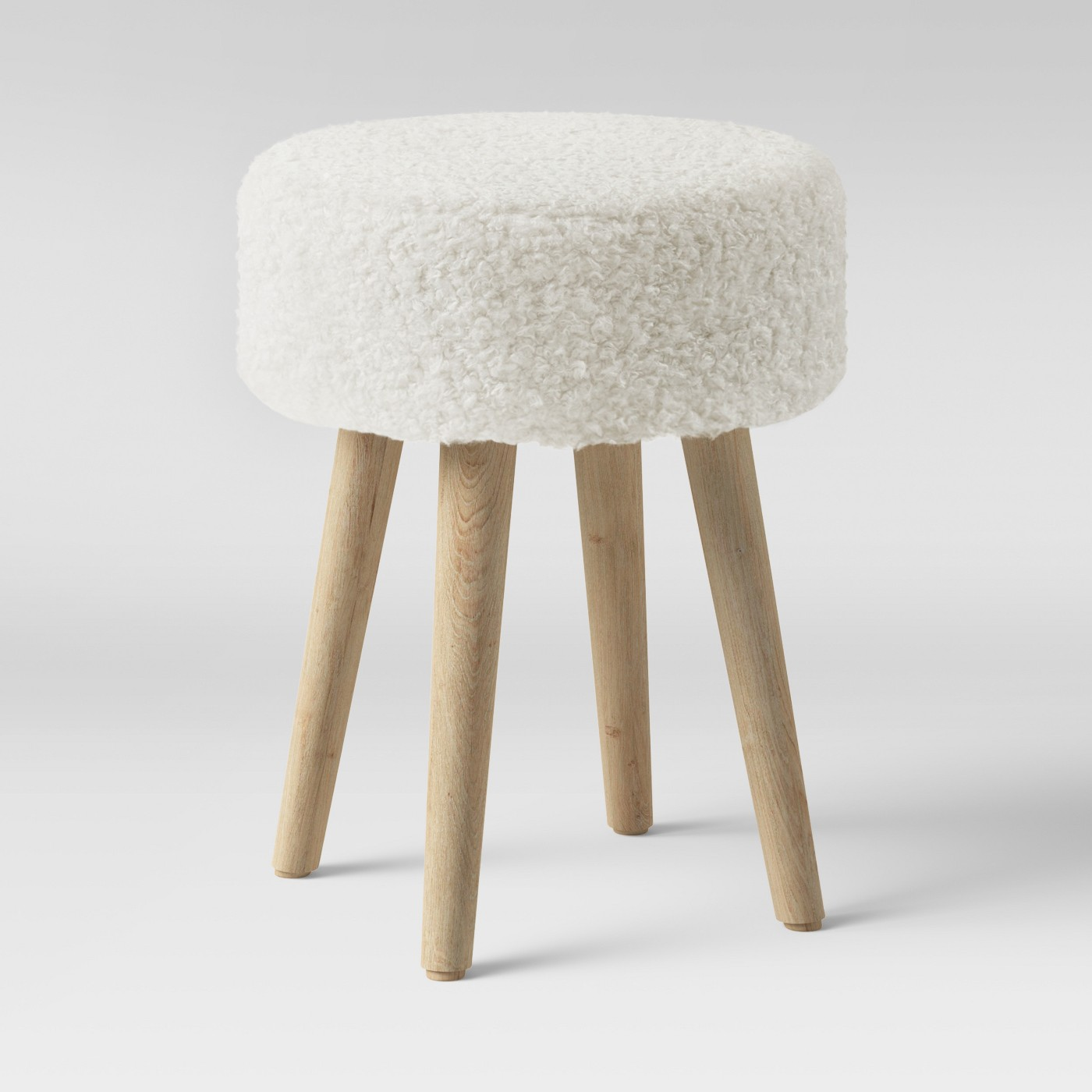 Sherpa ottoman with wooden legs