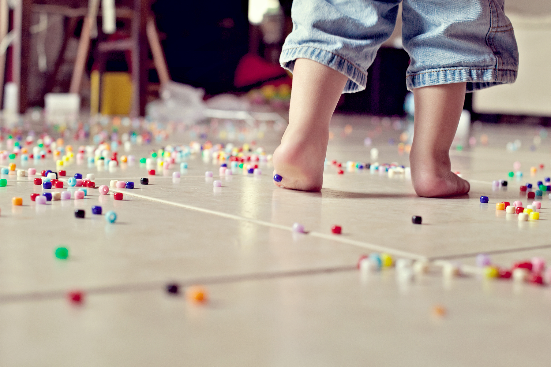 Toddler and spilled beads
