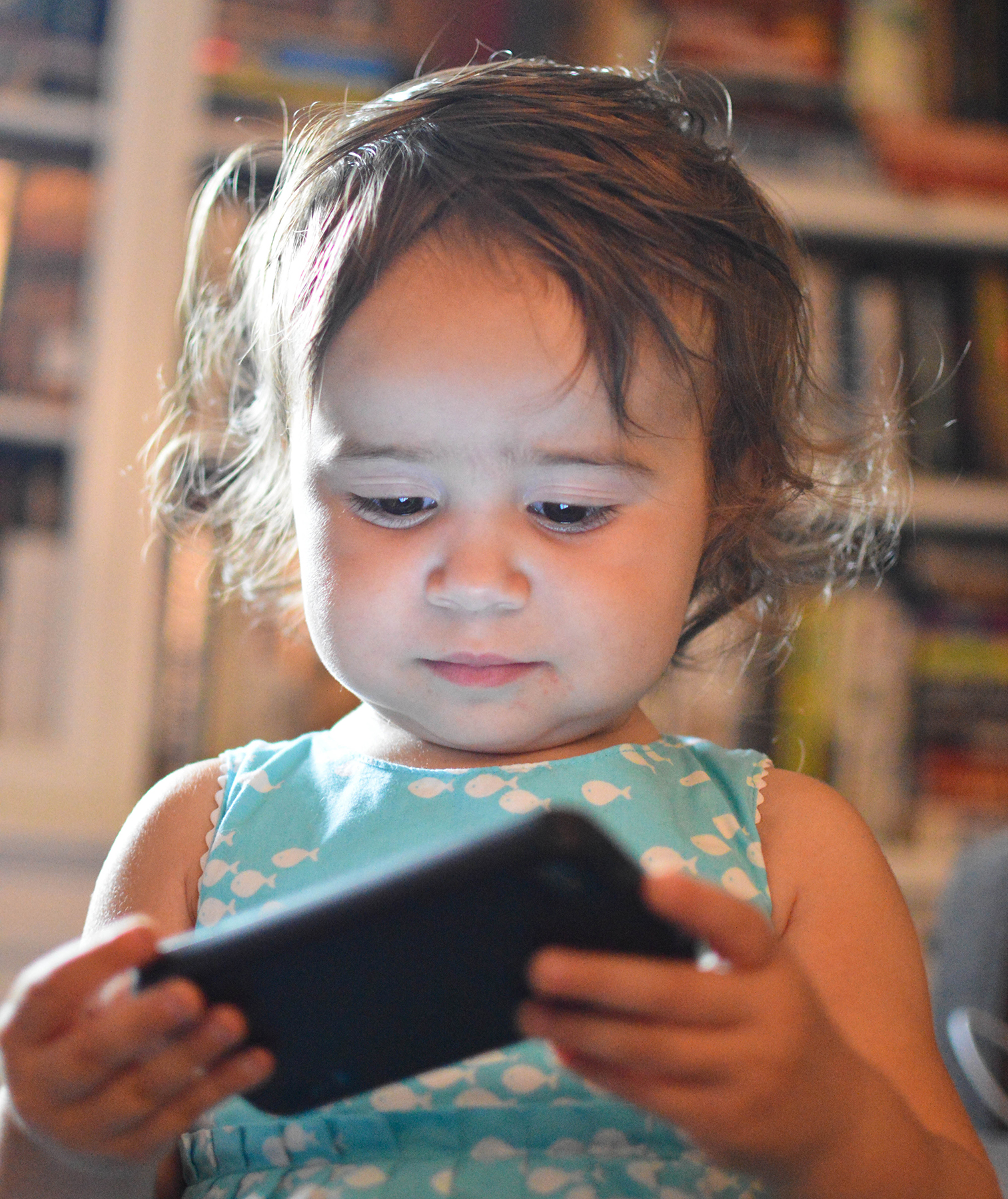 Toddler girl with cell phone
