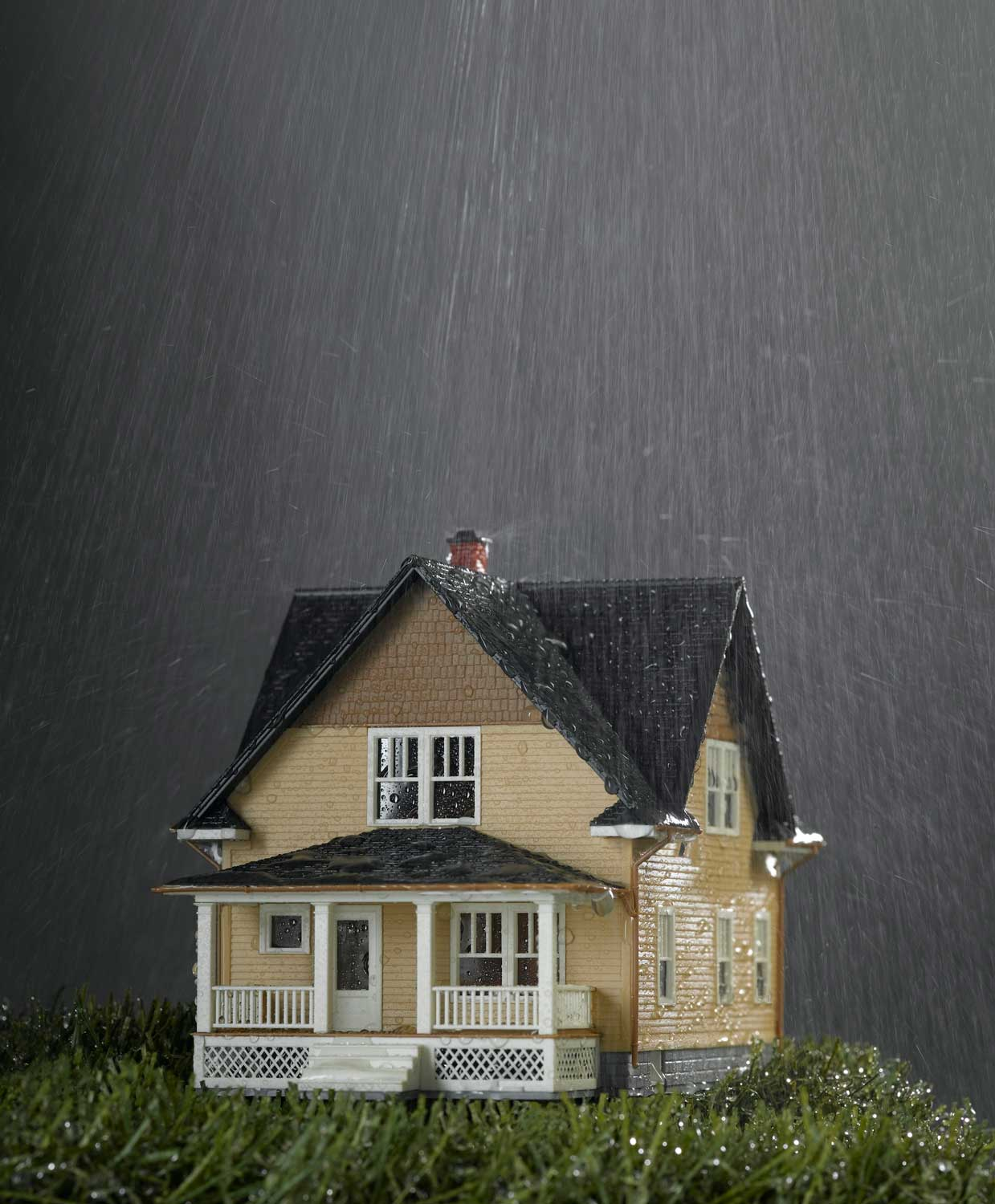Toy house in rain