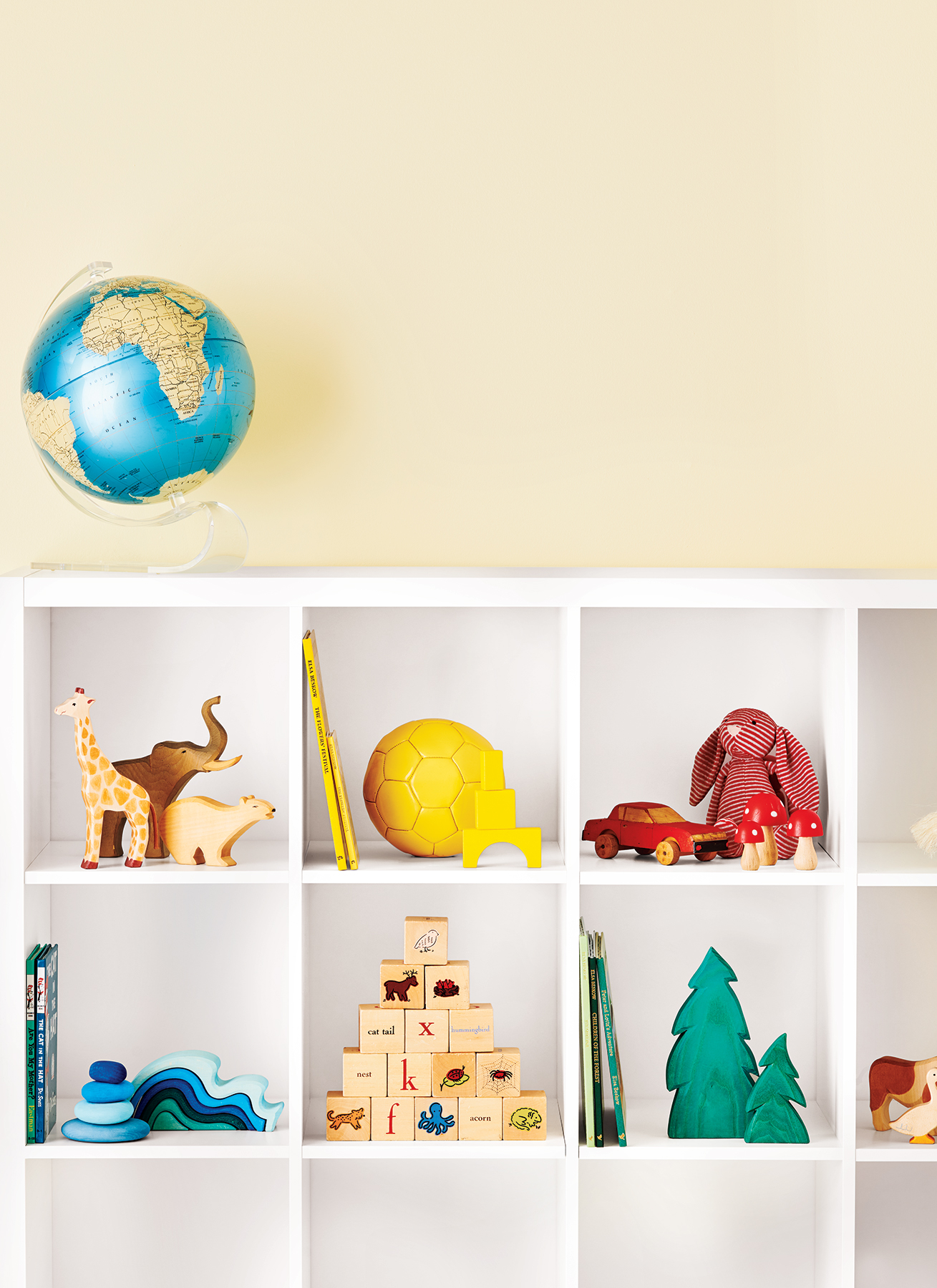 White shelving unit with colorful toys