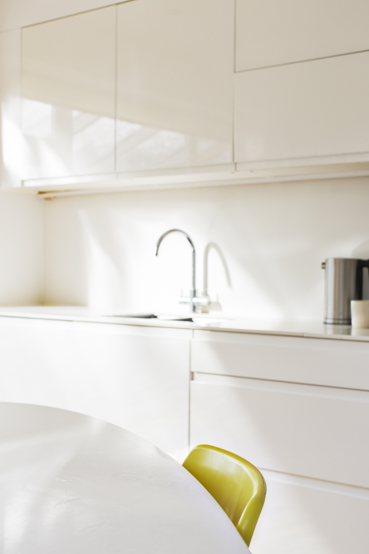 White modern kitchen cabinets and faucet