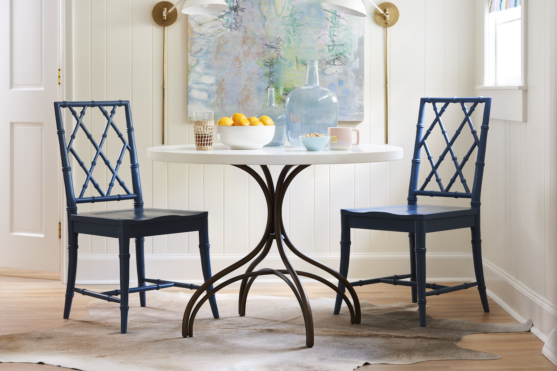 Blue x-back dining chairs around table
