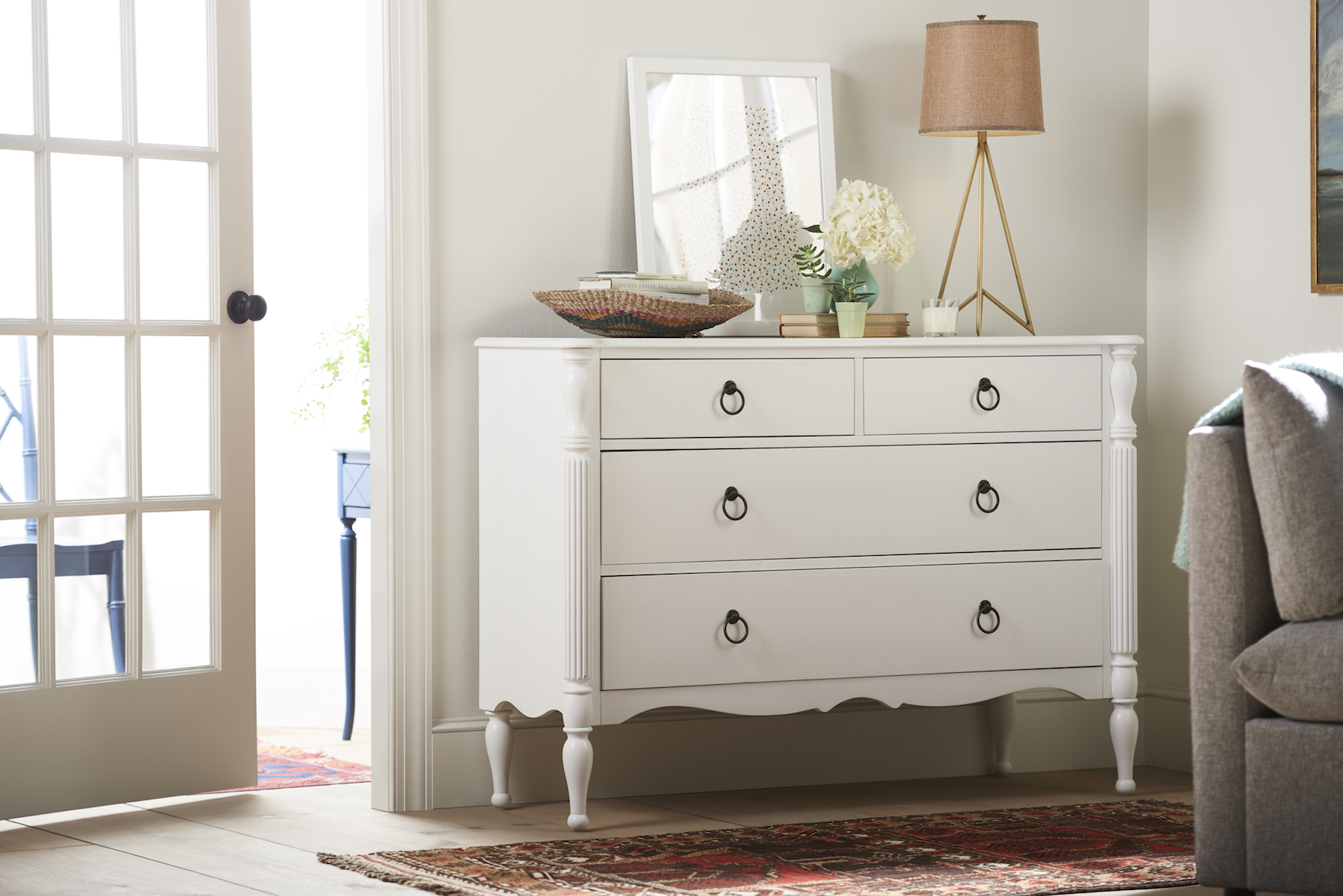 White dresser with drawer pulls in living room