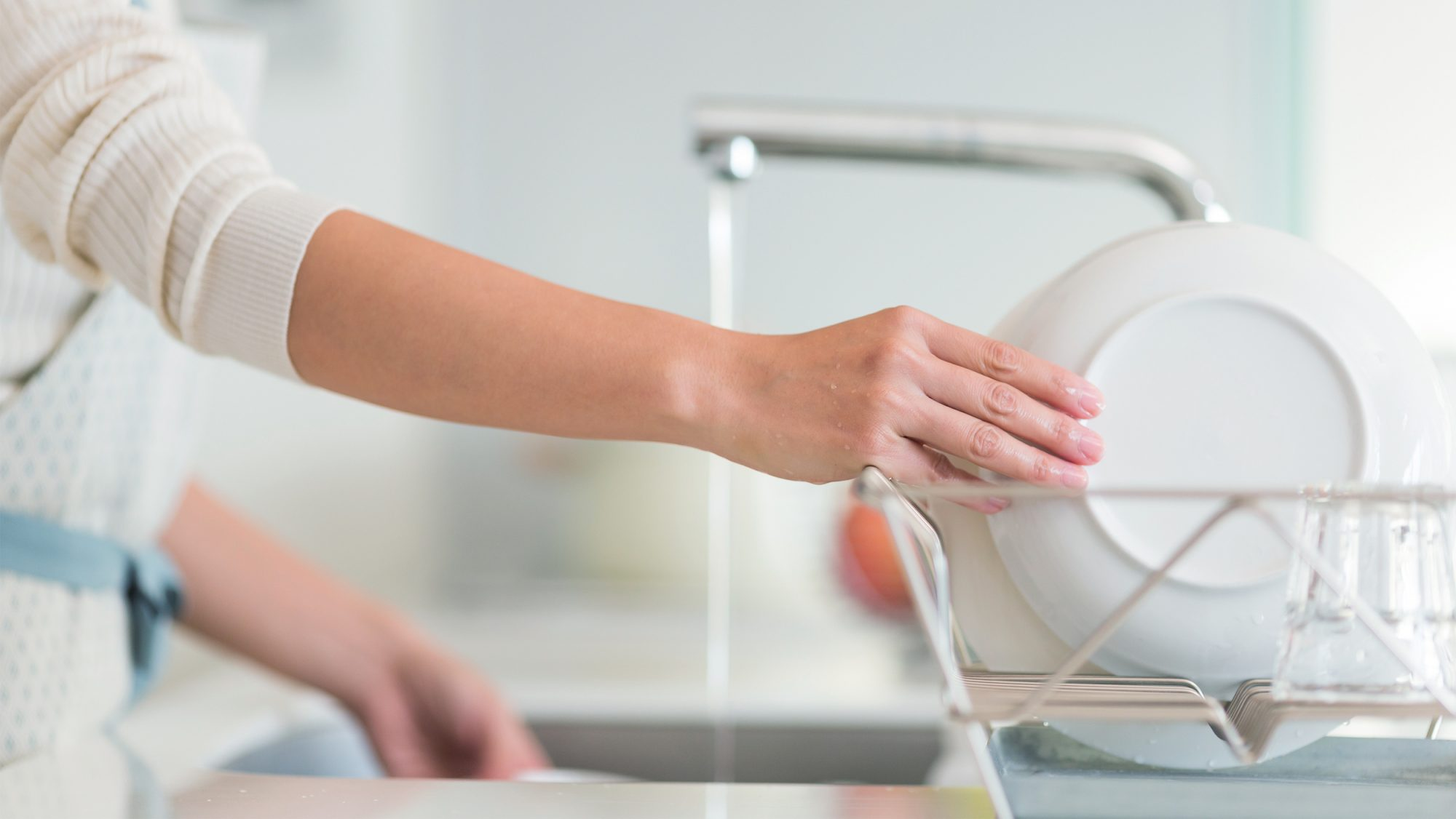 woman doing dishes, dish drying rack