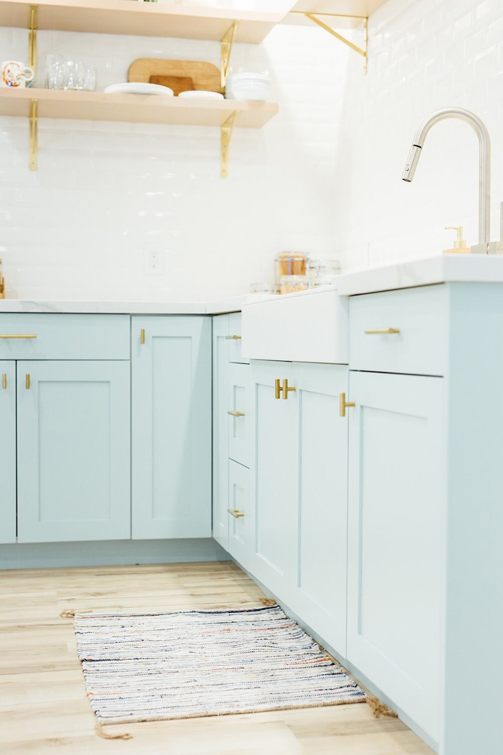 light blue kitchen cabinets and open shelving