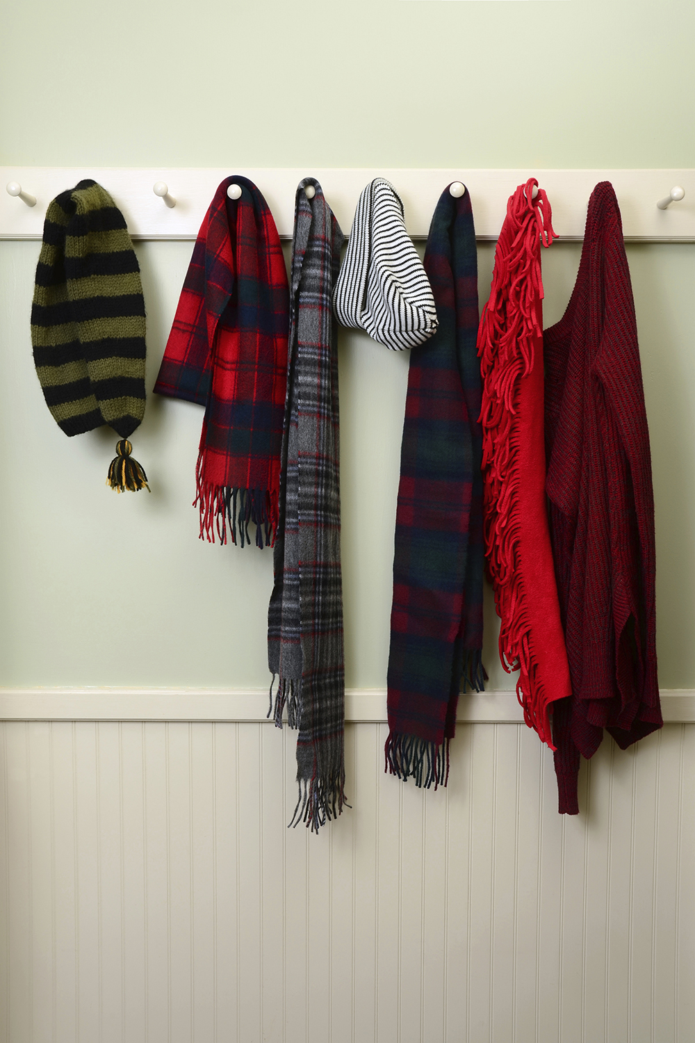 Scarves and hats on rack