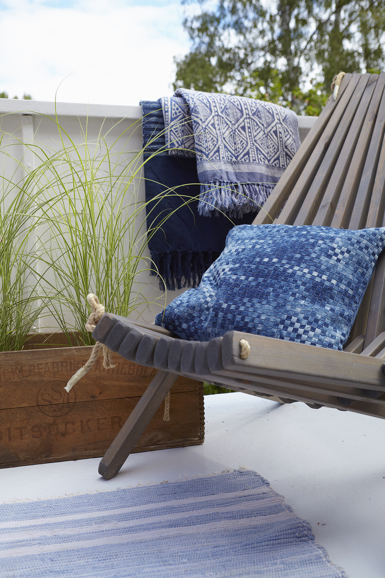 Sun chair on porch with blue pillow
