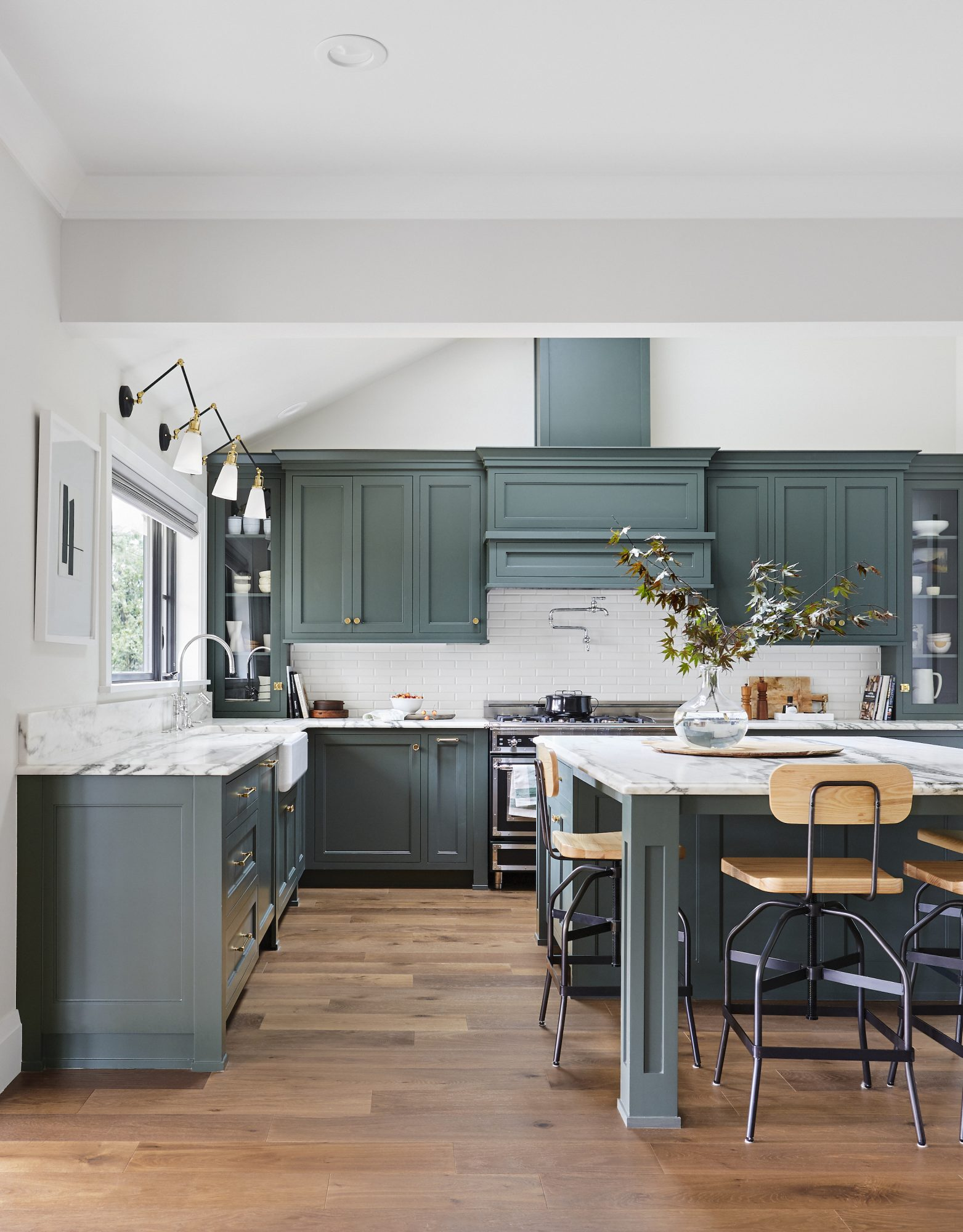 Beautiful kitchen with green cabinets