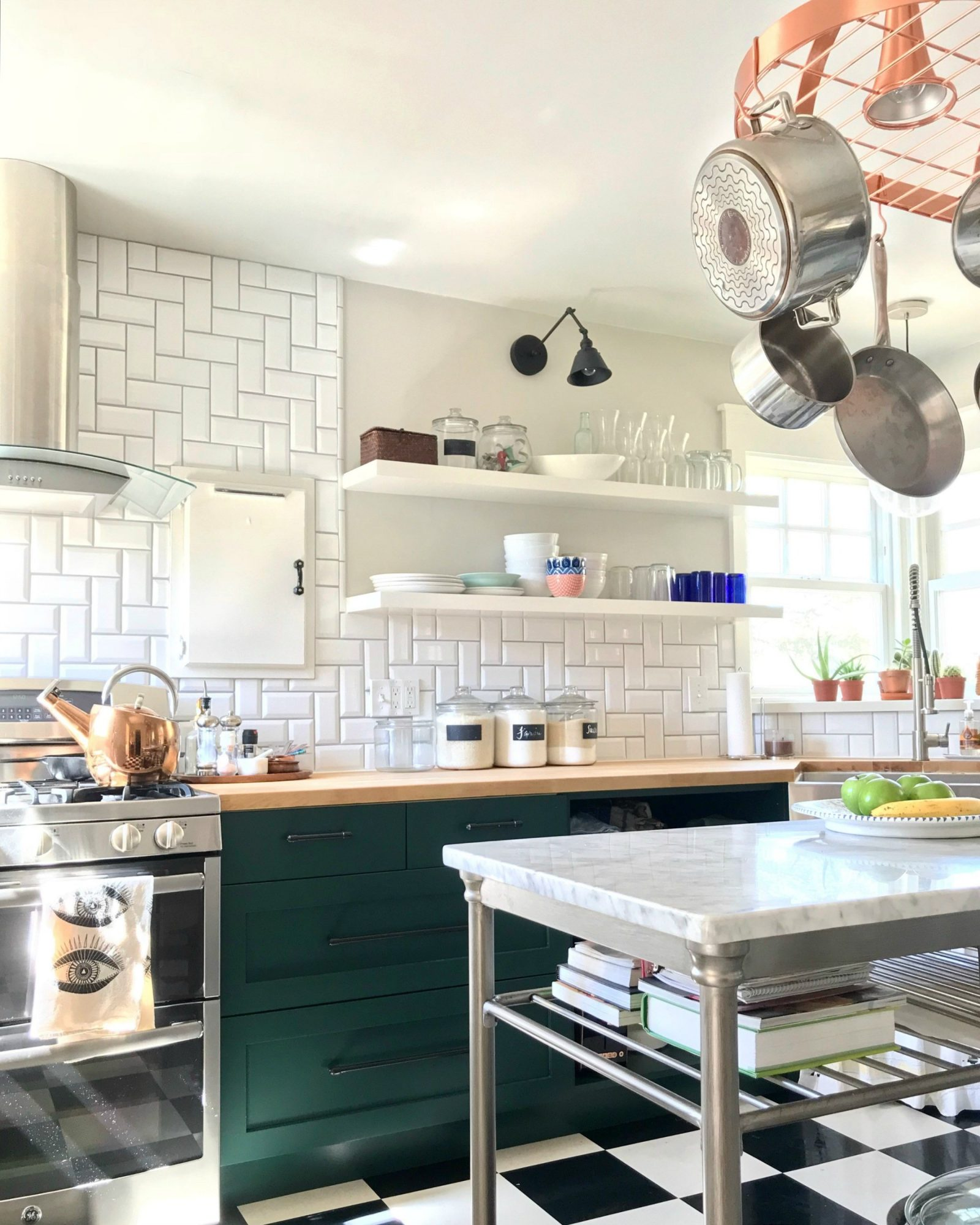 green lower kitchen cabinet with open shelving above