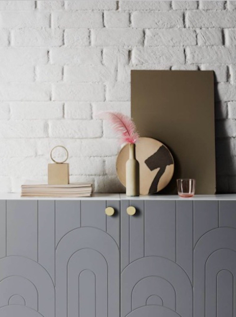 Grey IKEA Besta Cover with props on top