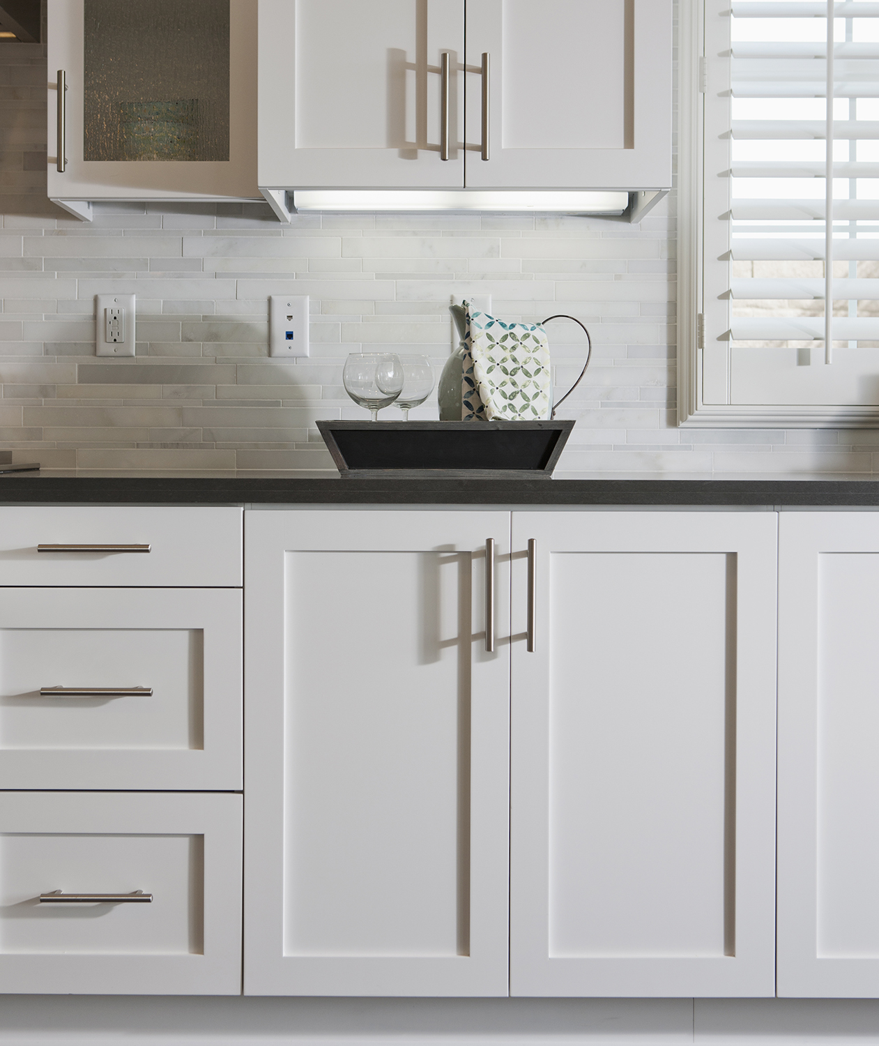 White kitchen cabinets with steel pulls