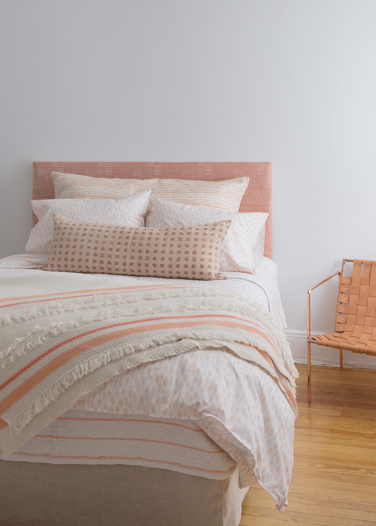 Bed with Rebecca Atwood coral bedding collection