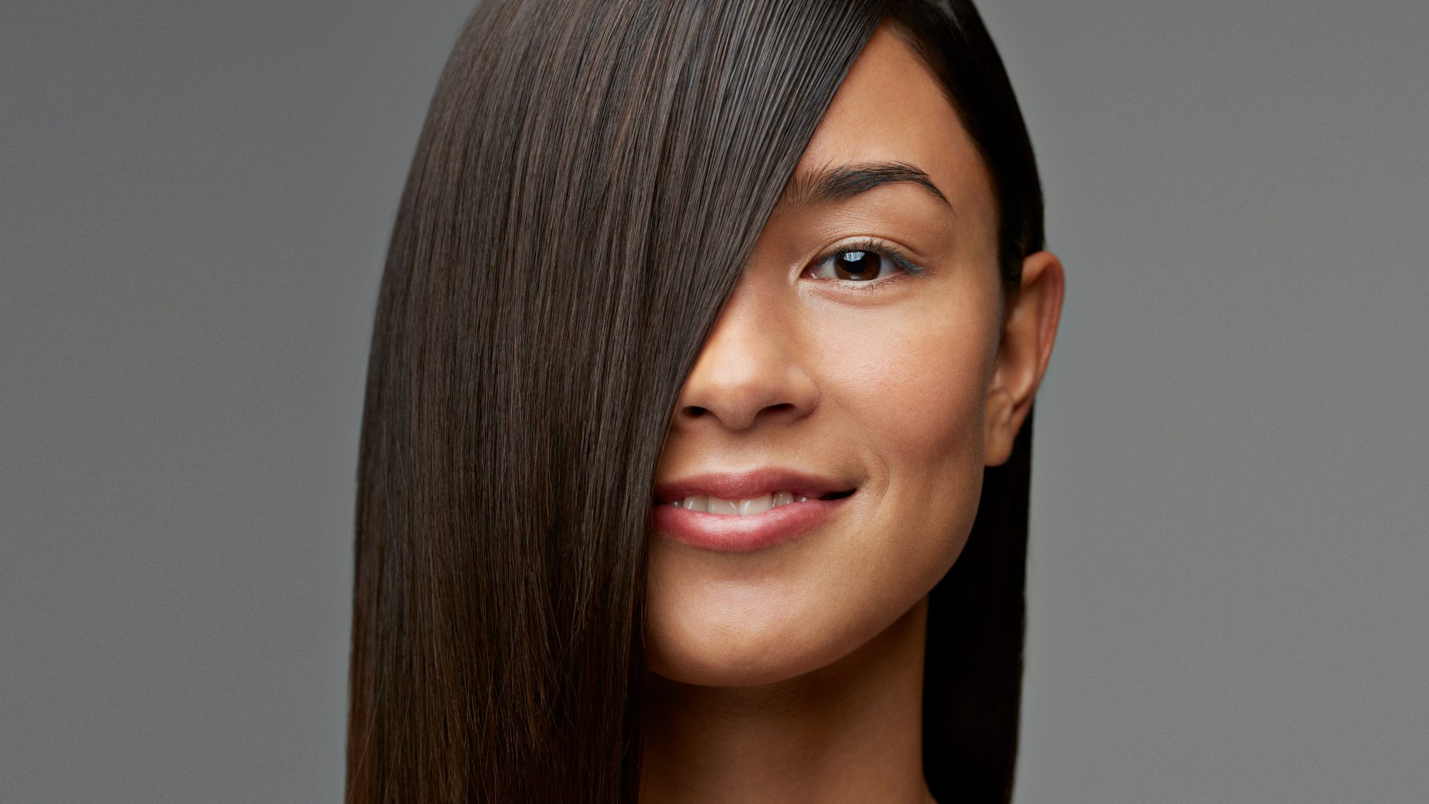 woman with sleek, straight hair