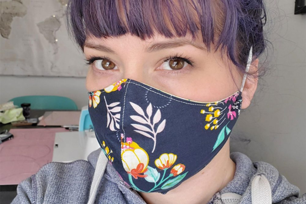 woman wearing face mask: Cricut has mobilized the crafting community to make face masks as part of its Millions of Masks challenge