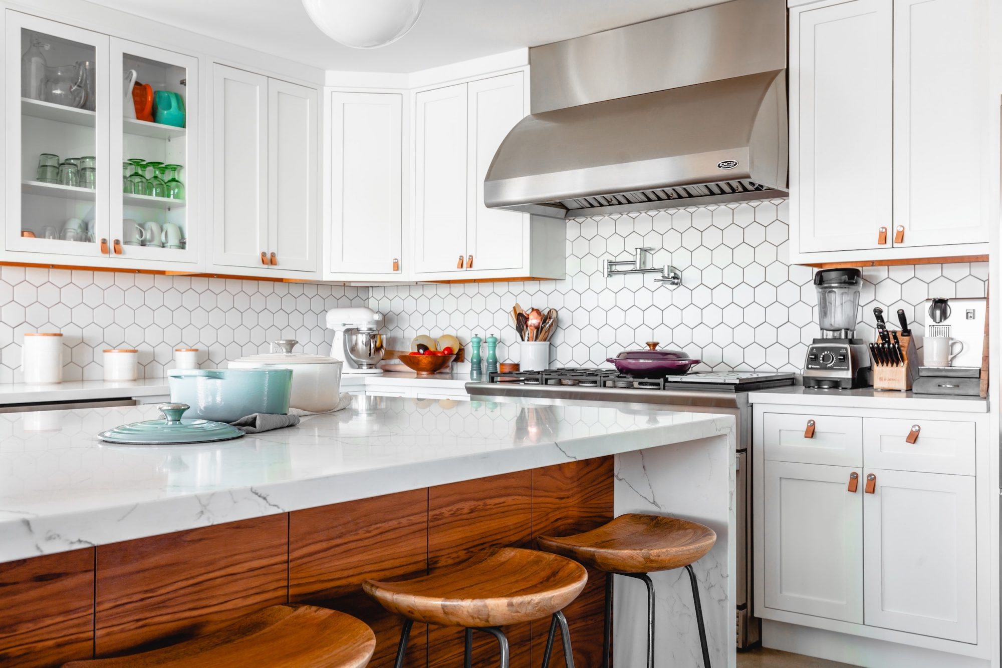 Kitchen with marble countertop and waterfall island