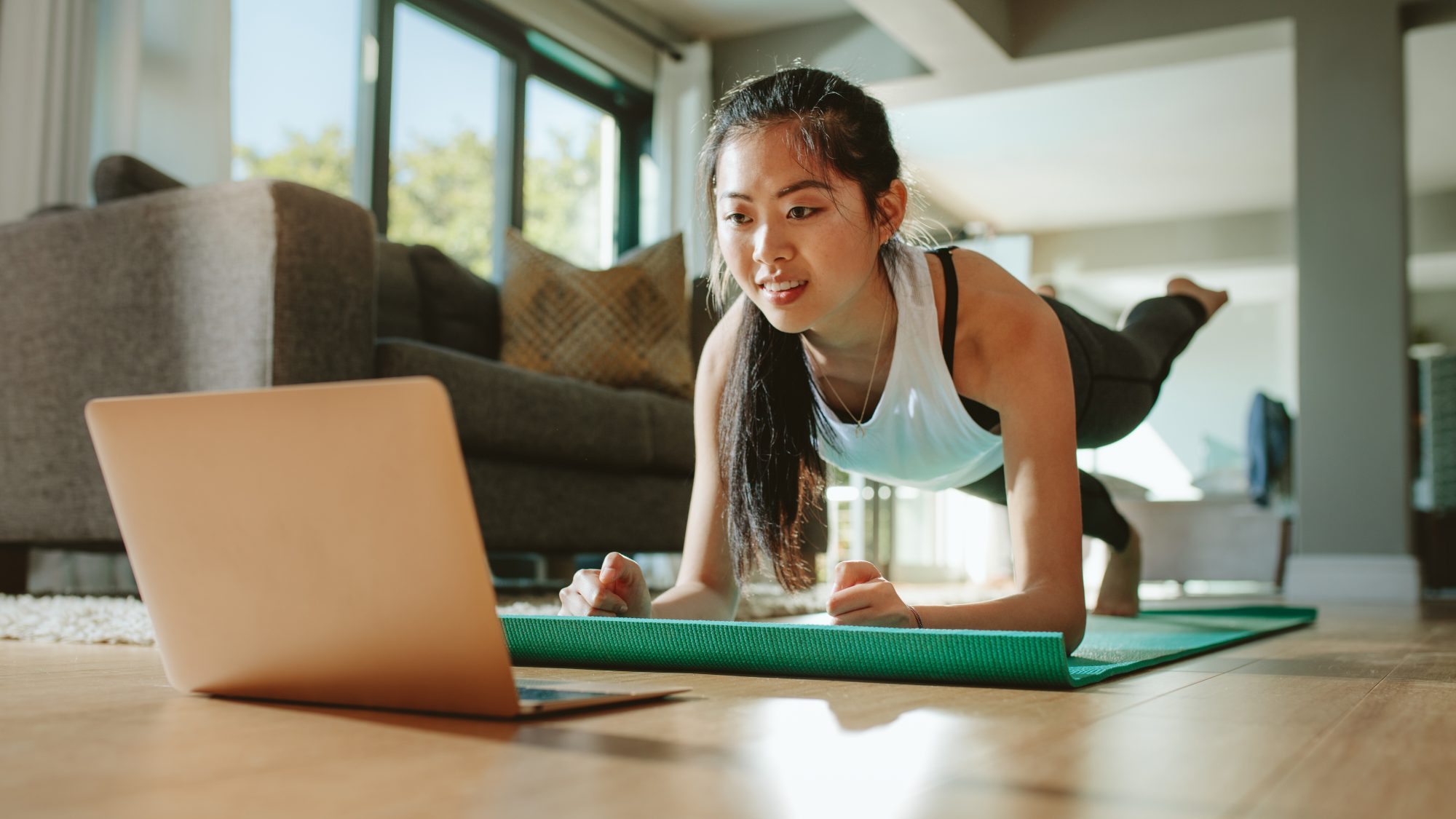 Better screen time: Woman watching sport training online on tablet