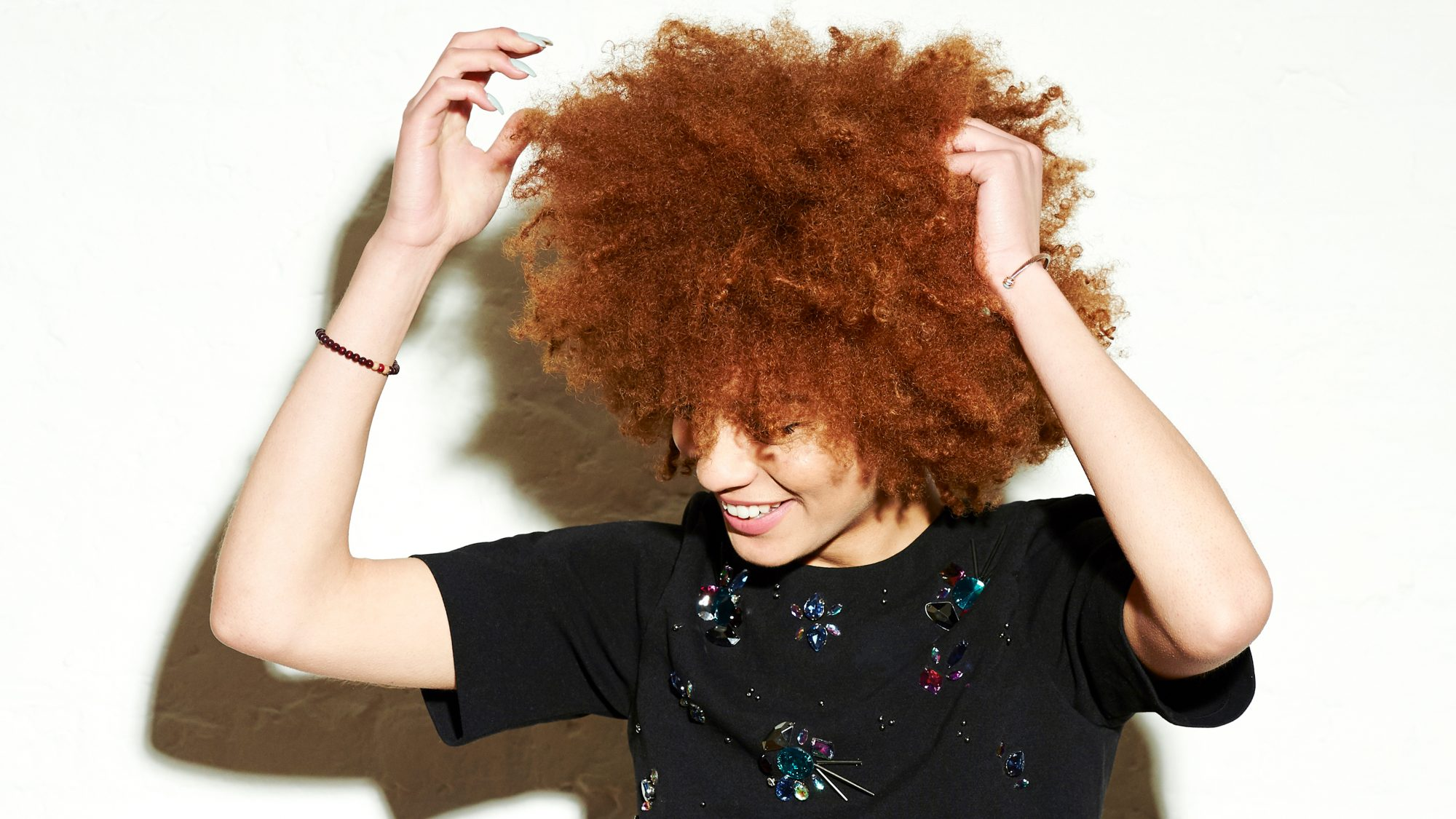 Woman fixing her afro