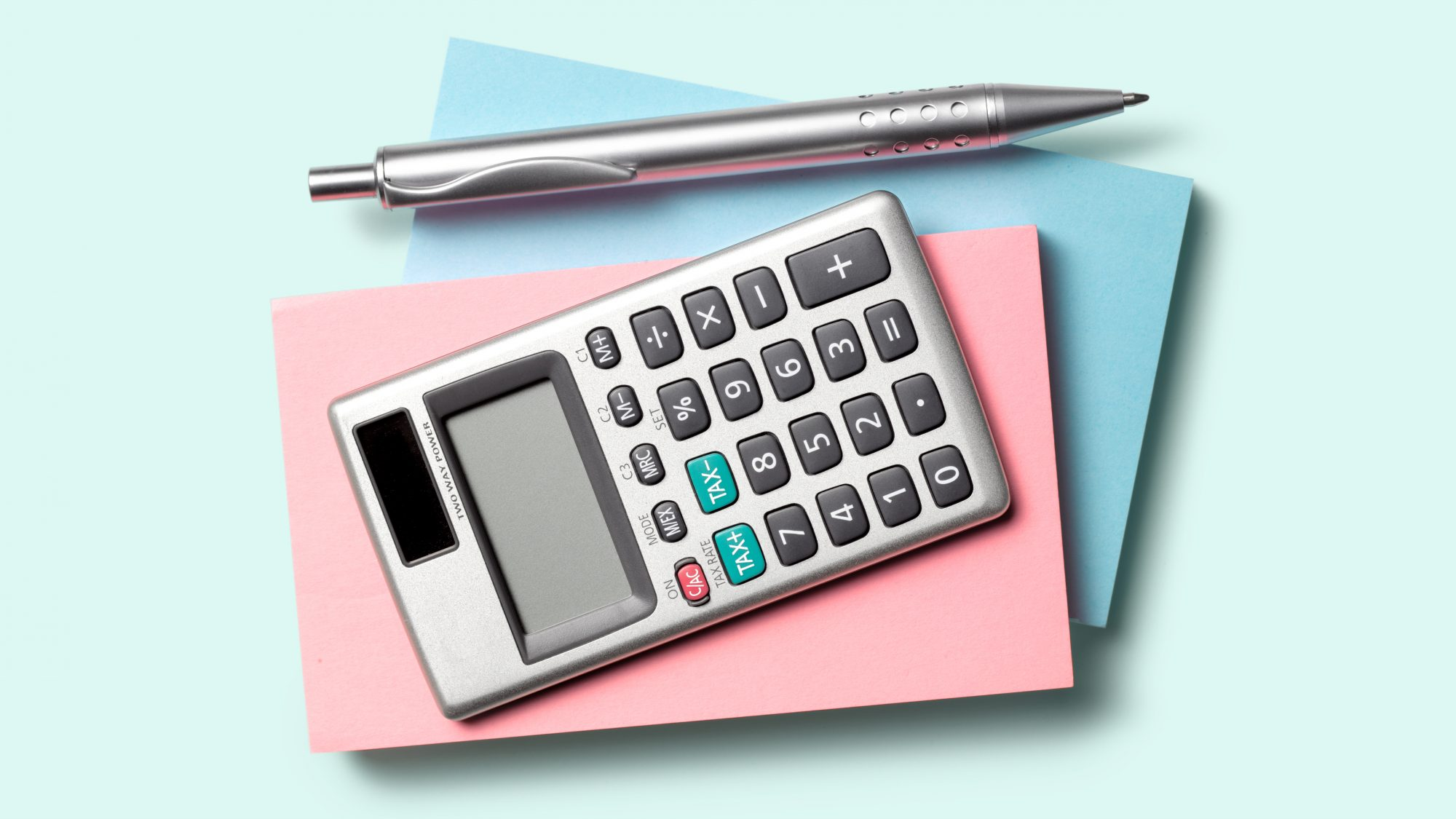 How to budget money: calculator and pen with budgeting notebook