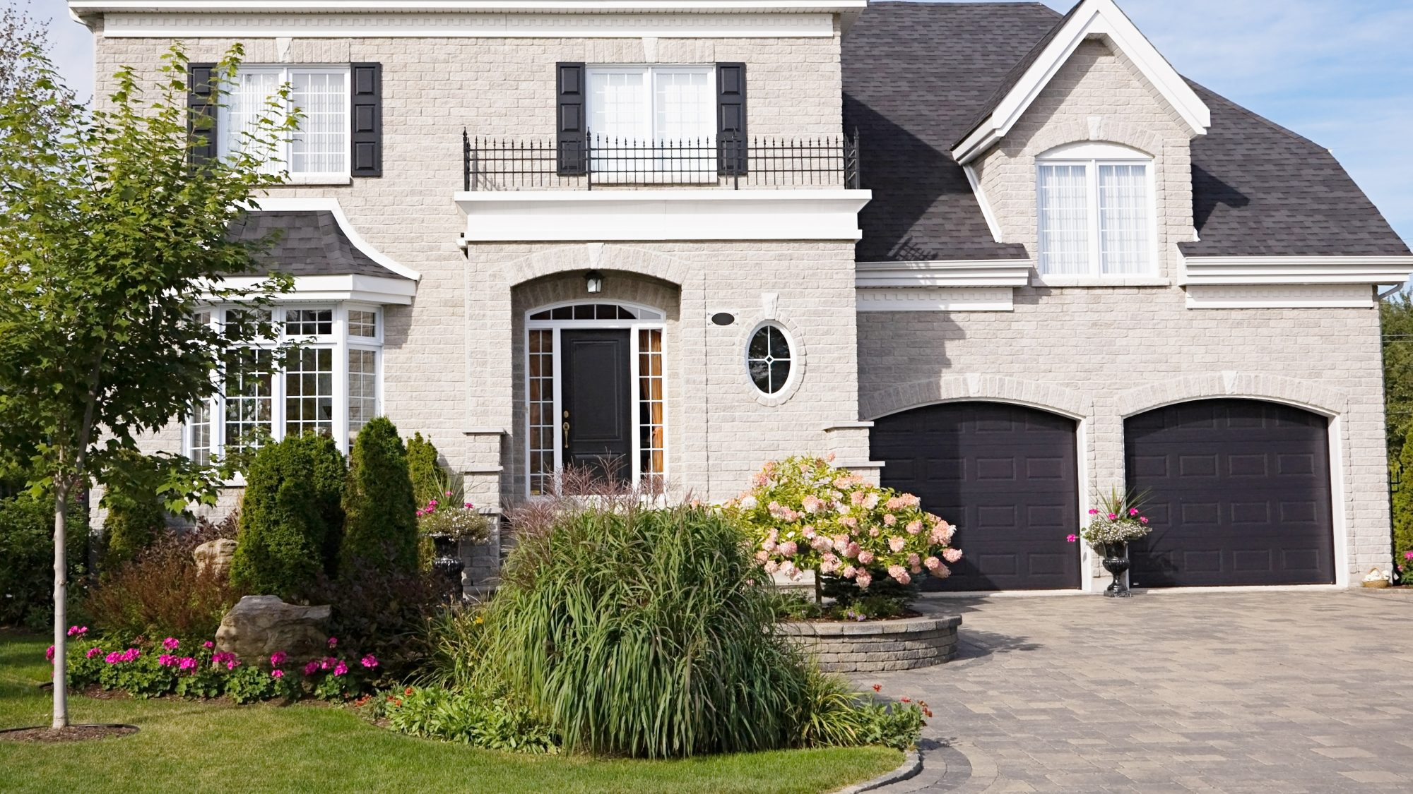 home exterior with front door and landscaping