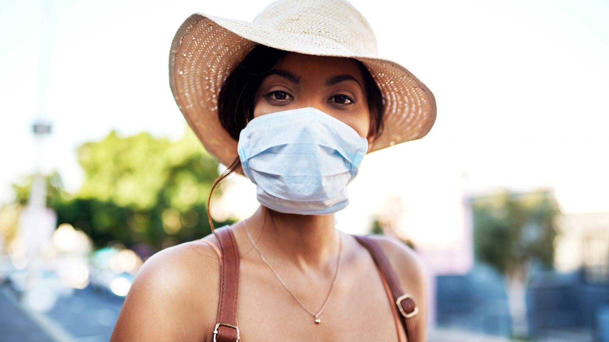 safe-practices-coronavirus: woman with face mask and hat