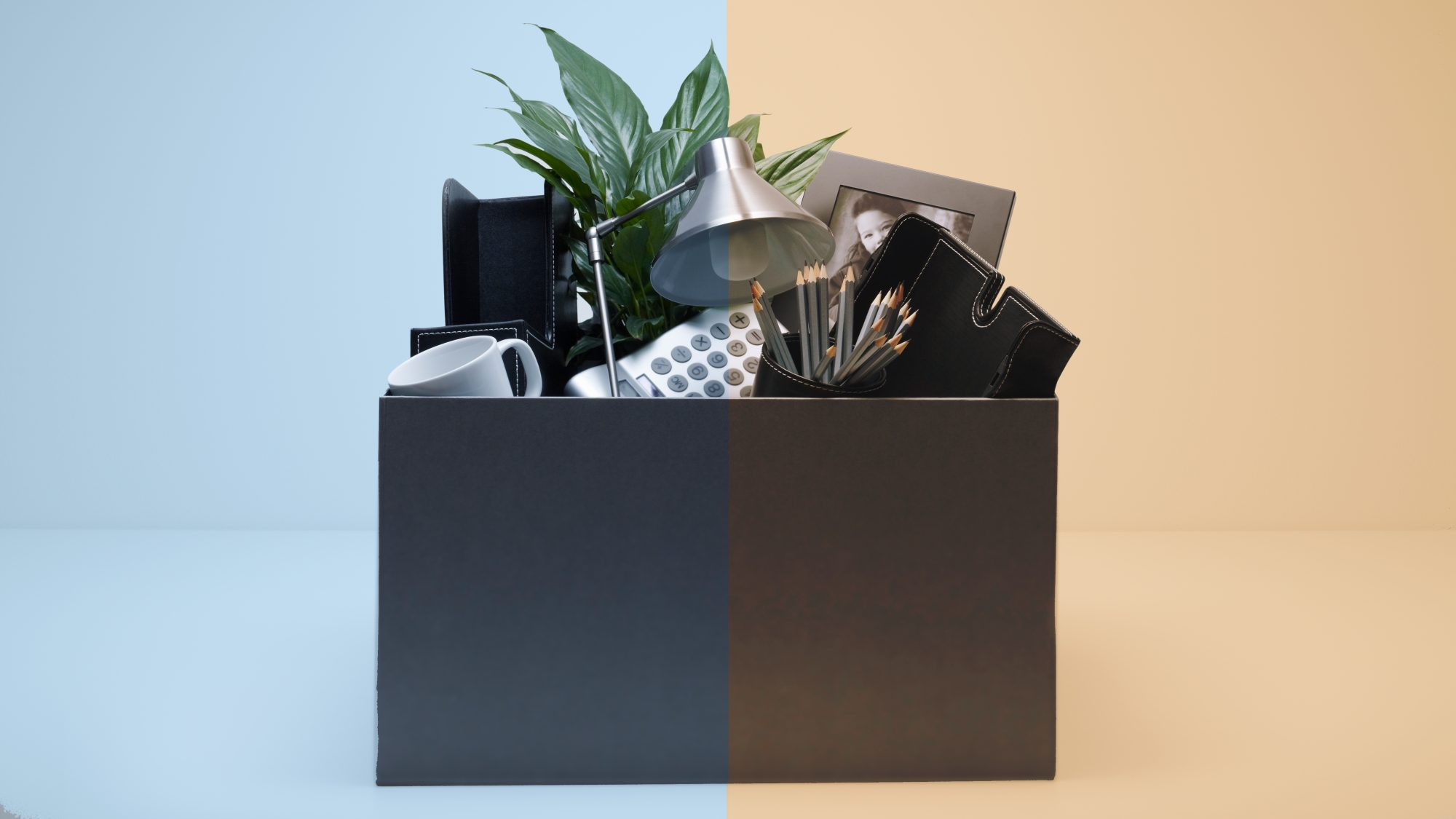 Furlough vs layoff: definition and difference (box of desk belongings)