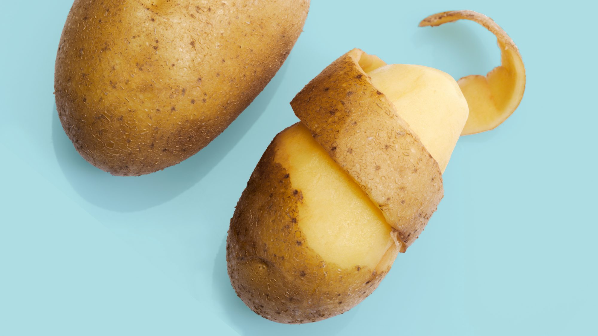 potato nutrition: half-peeled potato