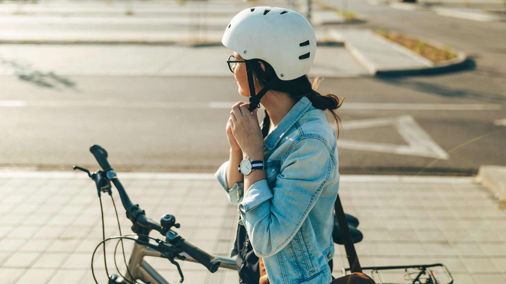 Biking etiquette and safety tips - woman on bike wearing helmet