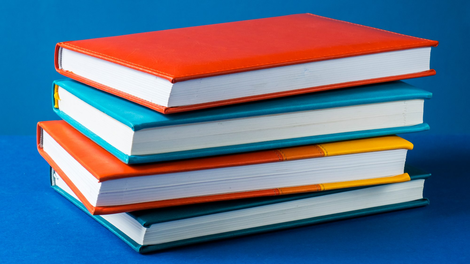 Books for college freshmen - 10 books every new college student should read (stack of books)