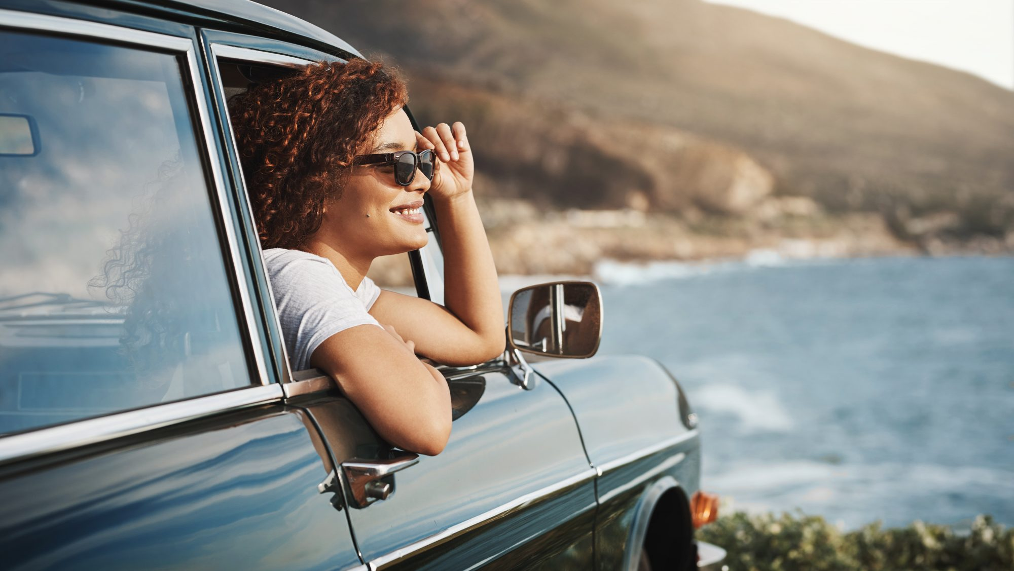 woman in car: fourth of july travel