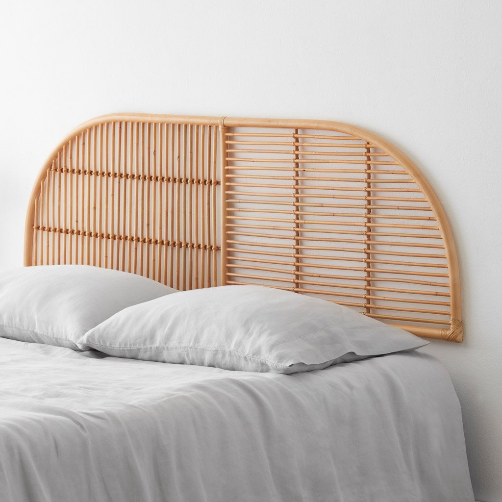 Rattan headboard behind bed