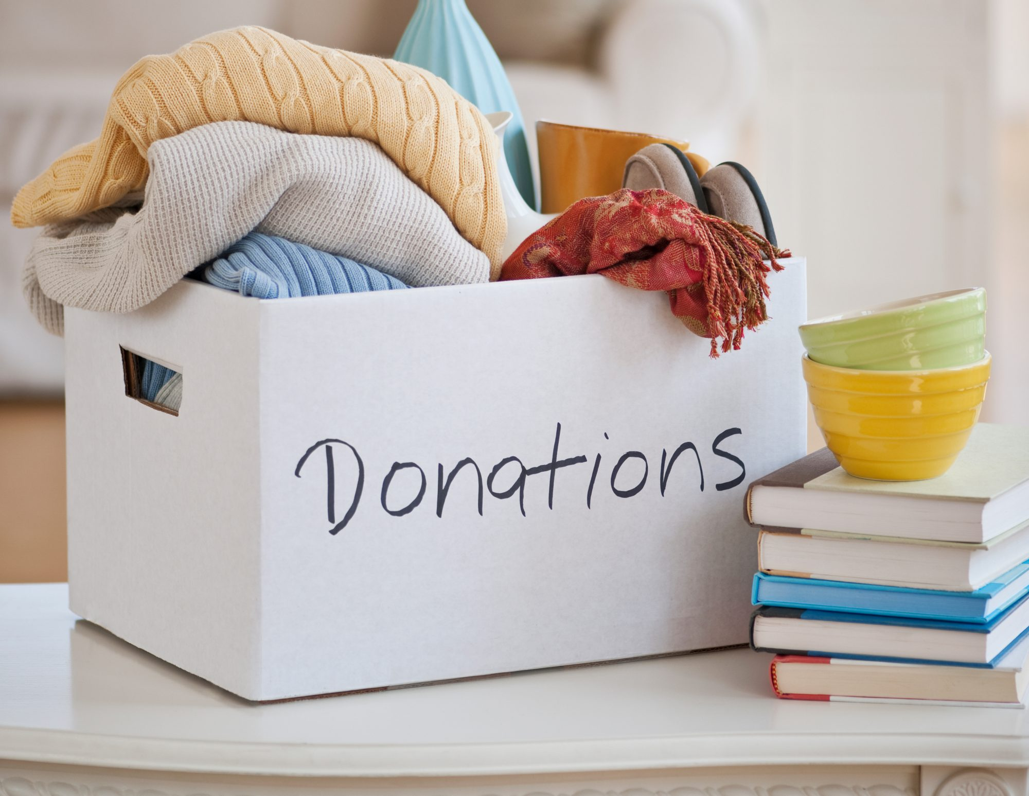 Where to donate during covid - clothes, books in donation box