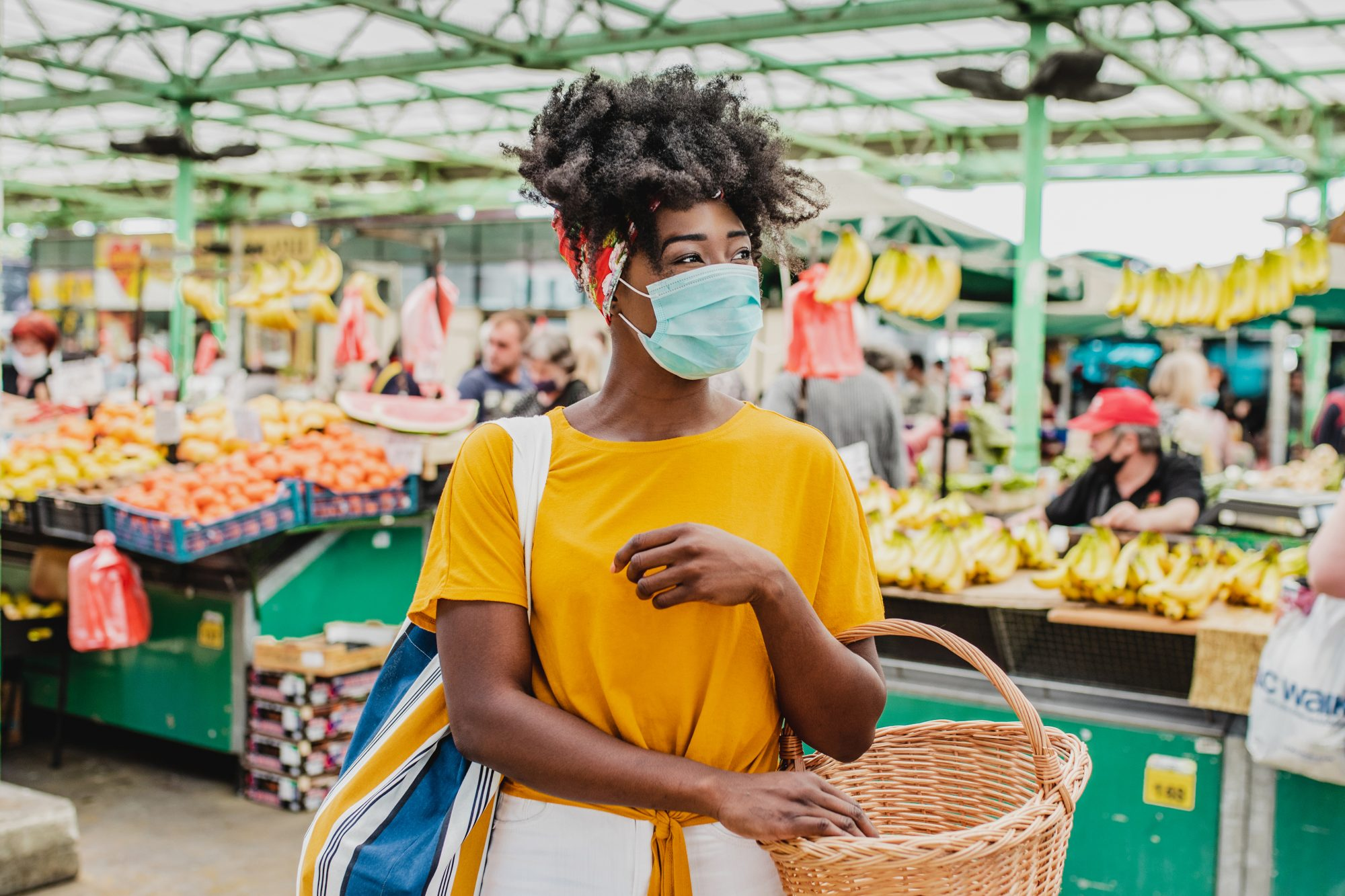 How to shop at farmers markets during coronavirus - woman shopping at market with mask