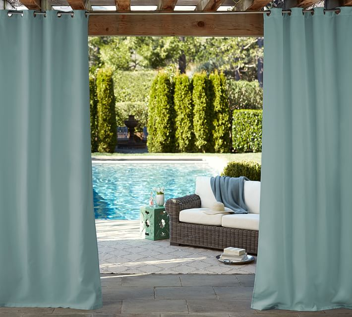Pergola with teal blue curtains in backyard