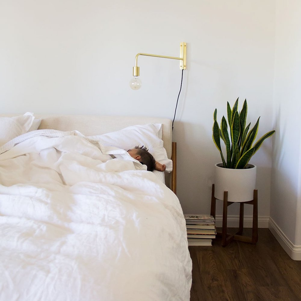 White linen bed sheets from Brooklinen on bed