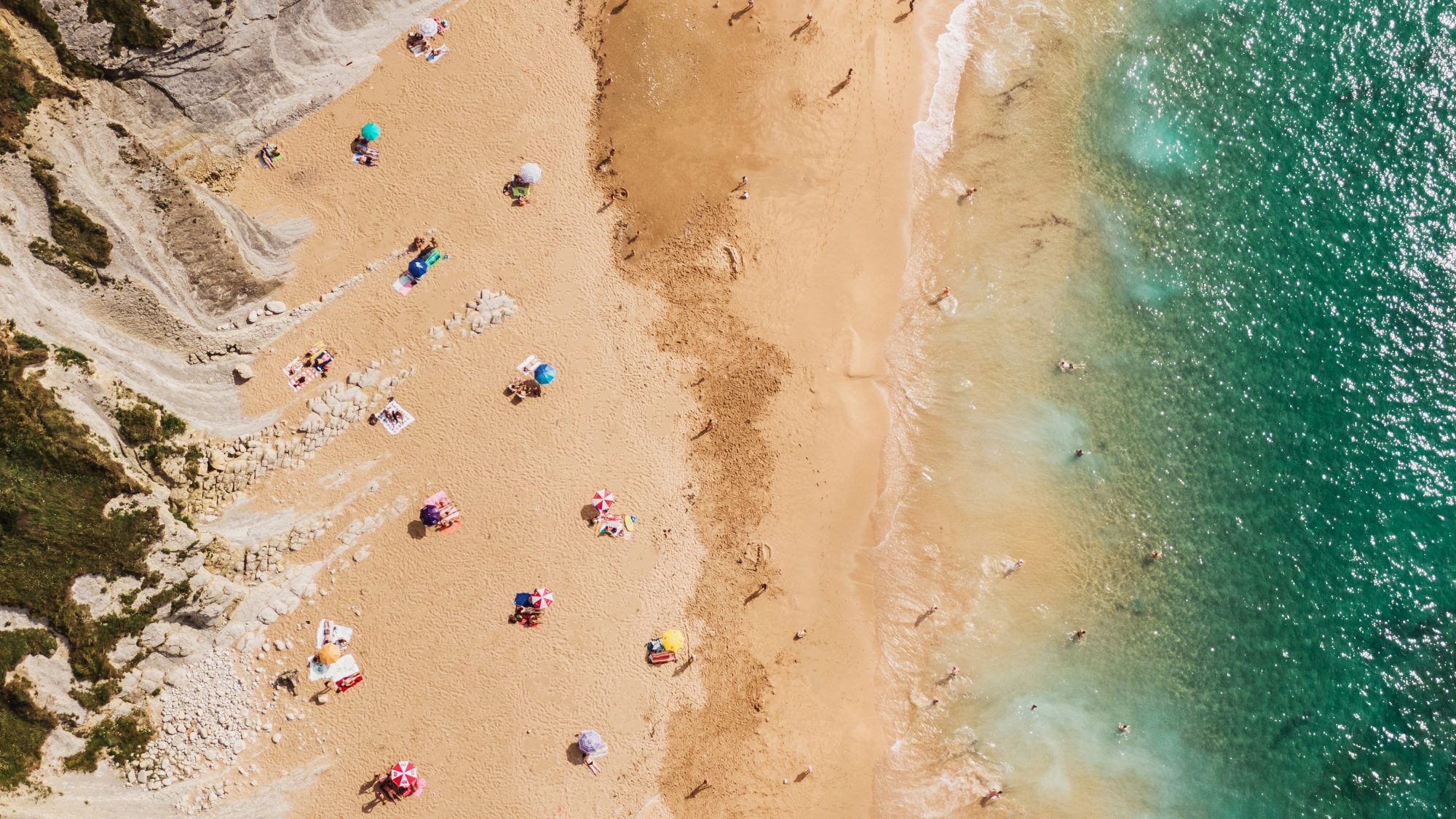 aerial view of people social distancing on the beach