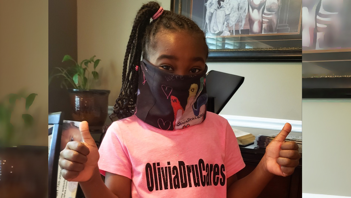 Olivia Dru Tyler hands out masks to those in need in Chicago area