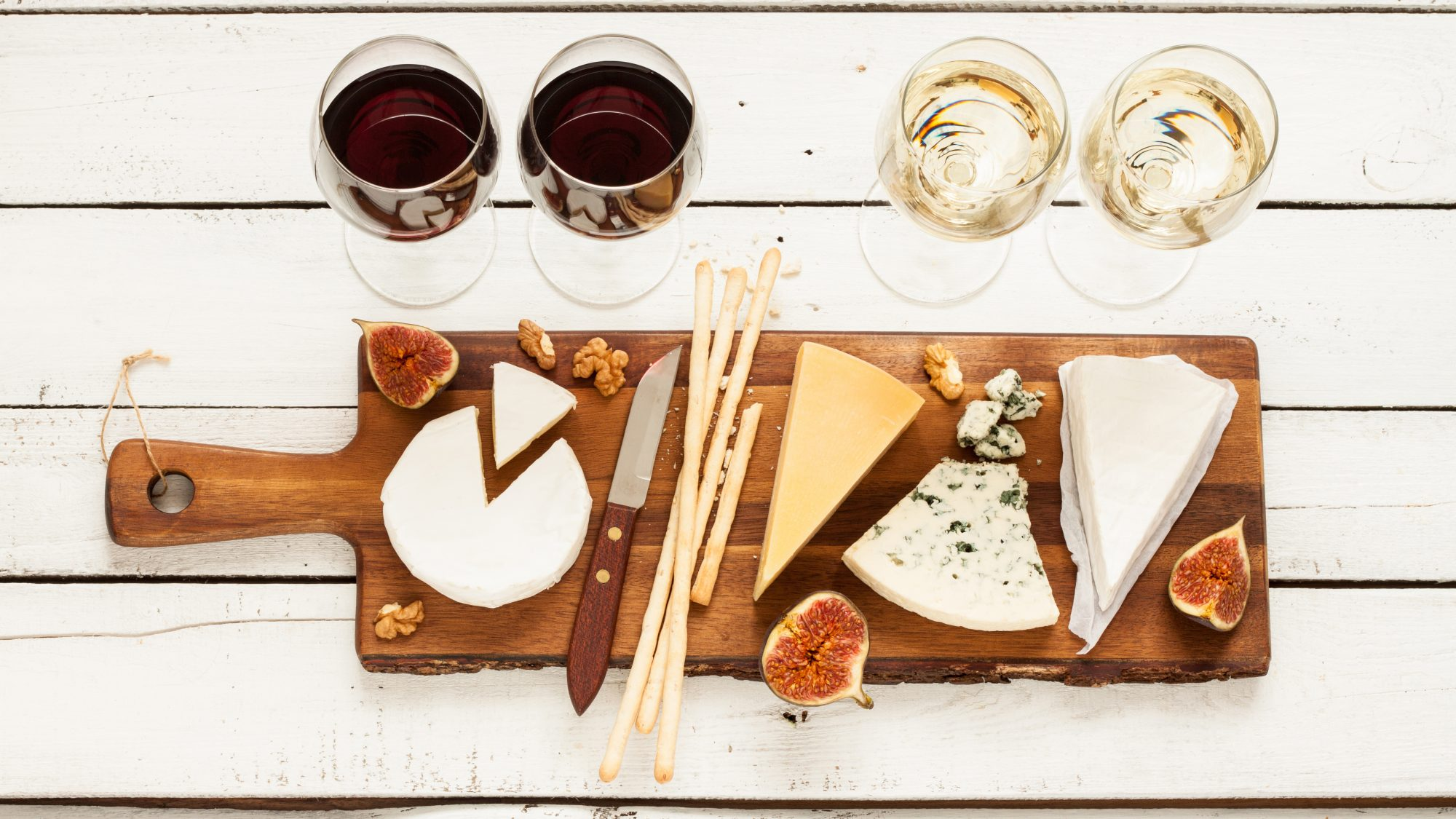 cheese platter with wine: wine and cheese pairing mistakes
