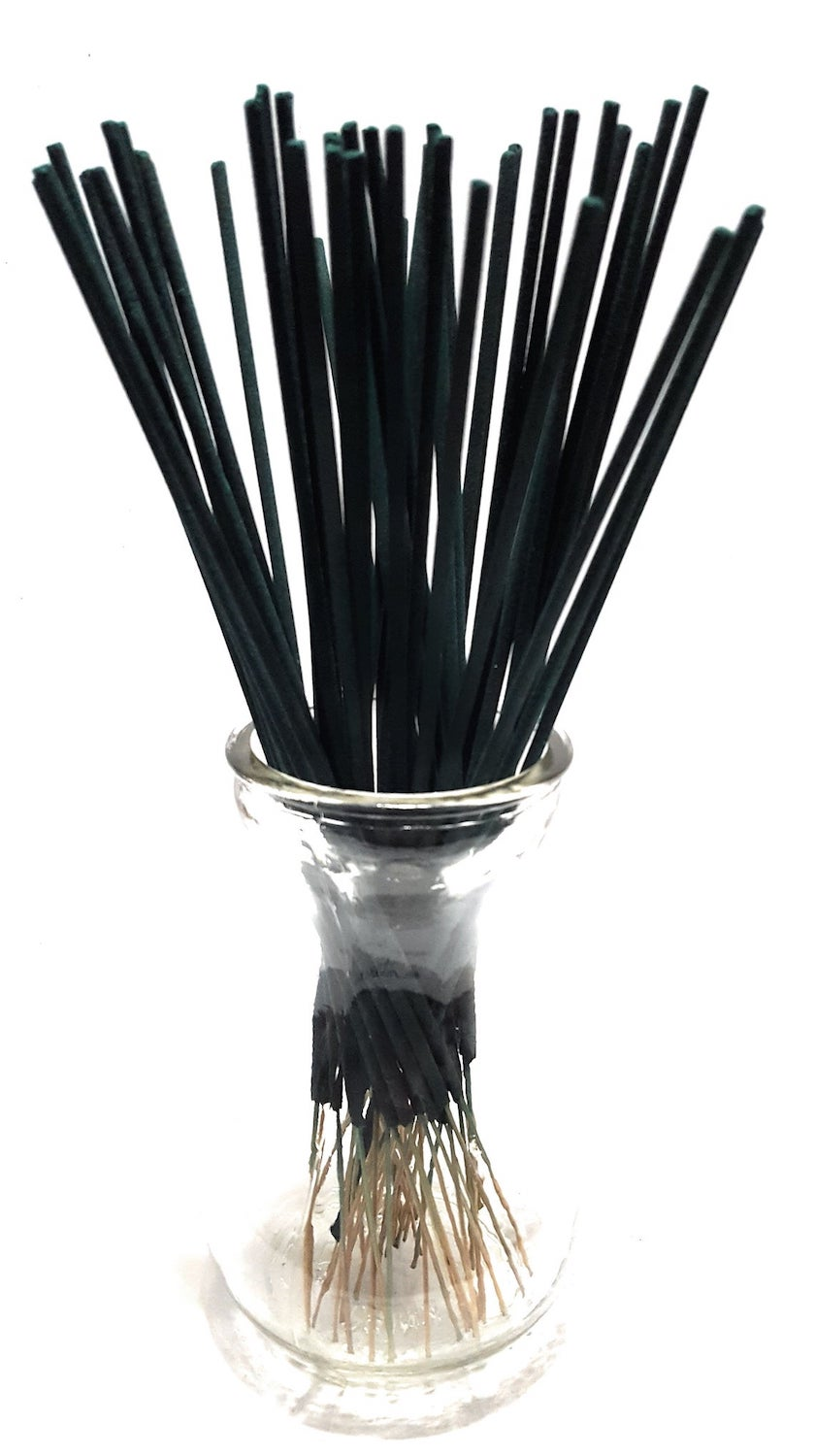 Mosquito incense sticks in glass holder