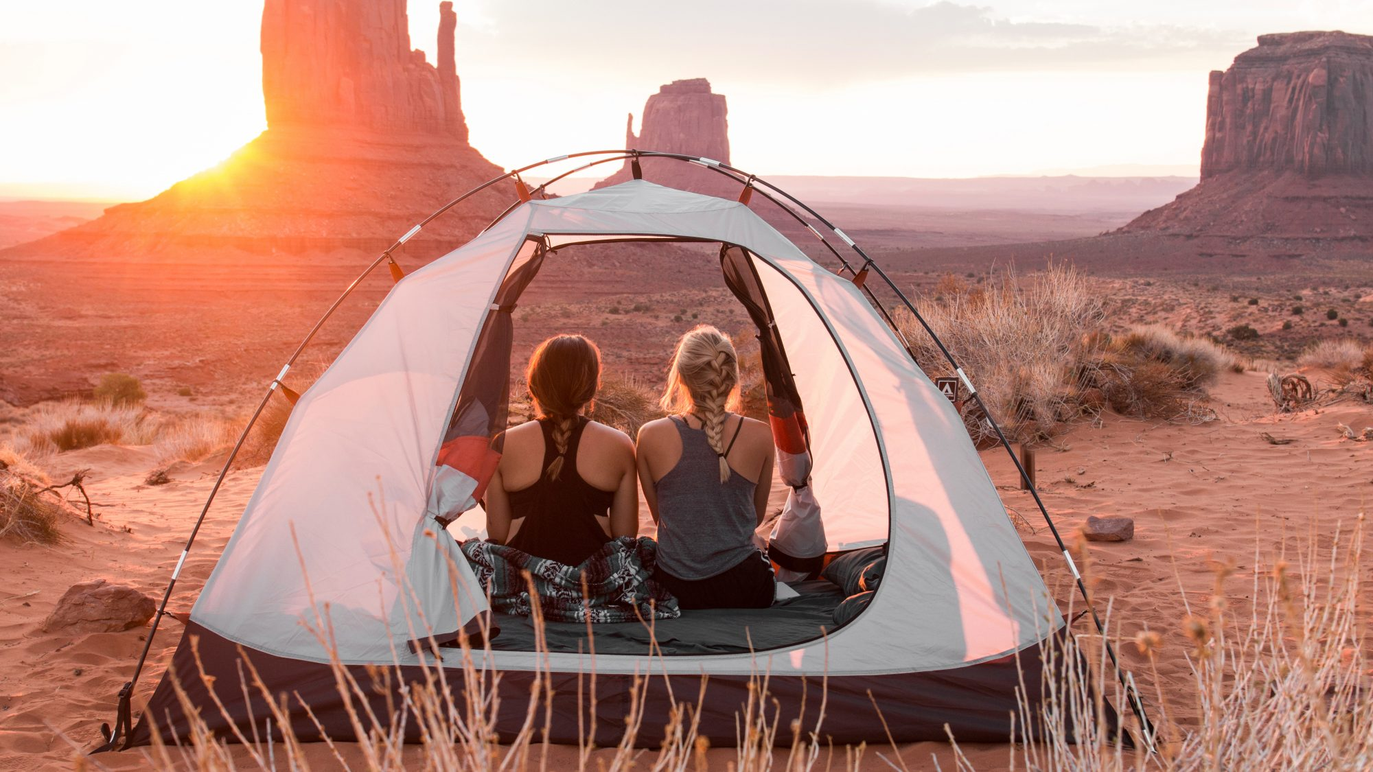 camping-essentials: two women in a tent