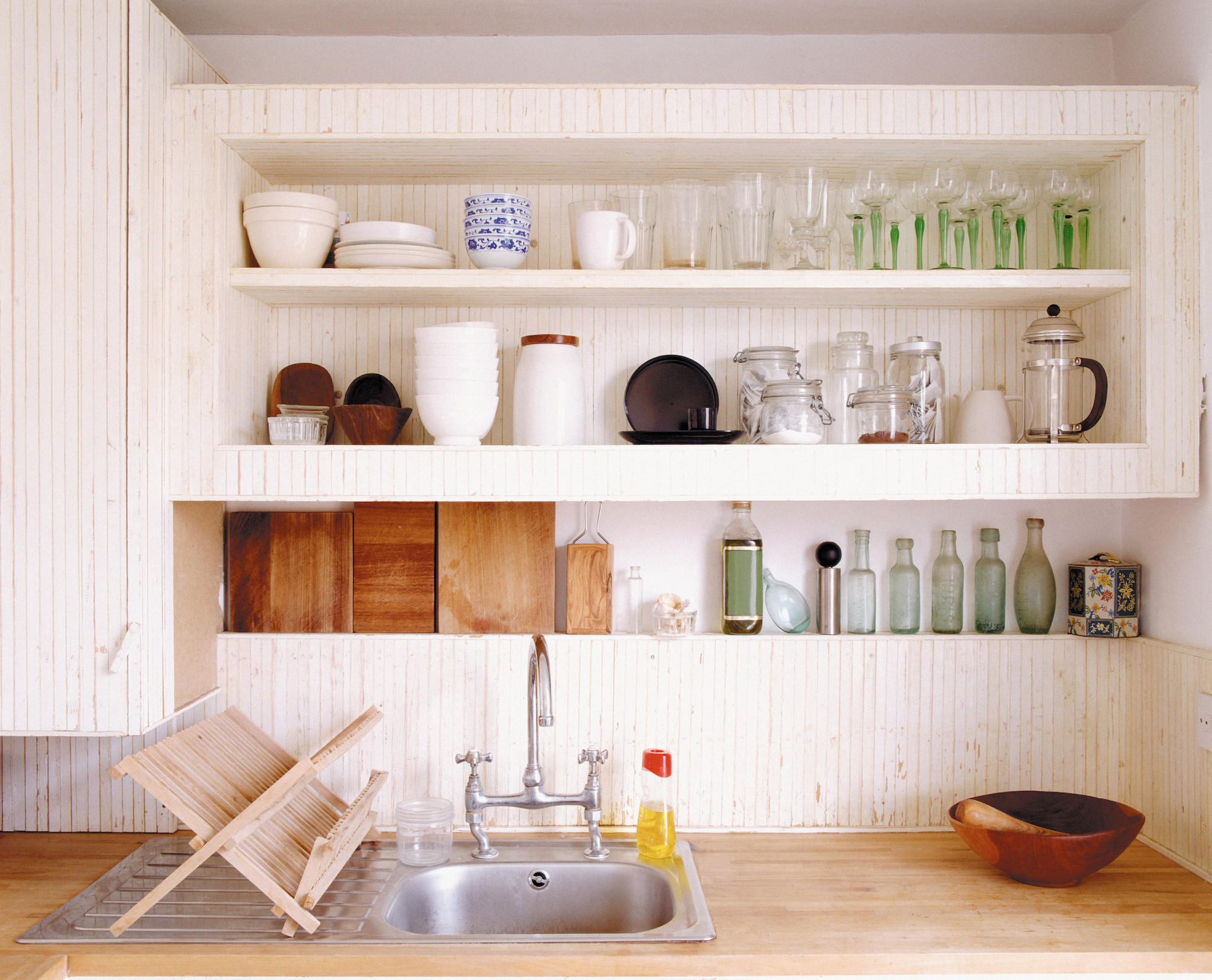 open shelving in kitchen with dishware and glasses