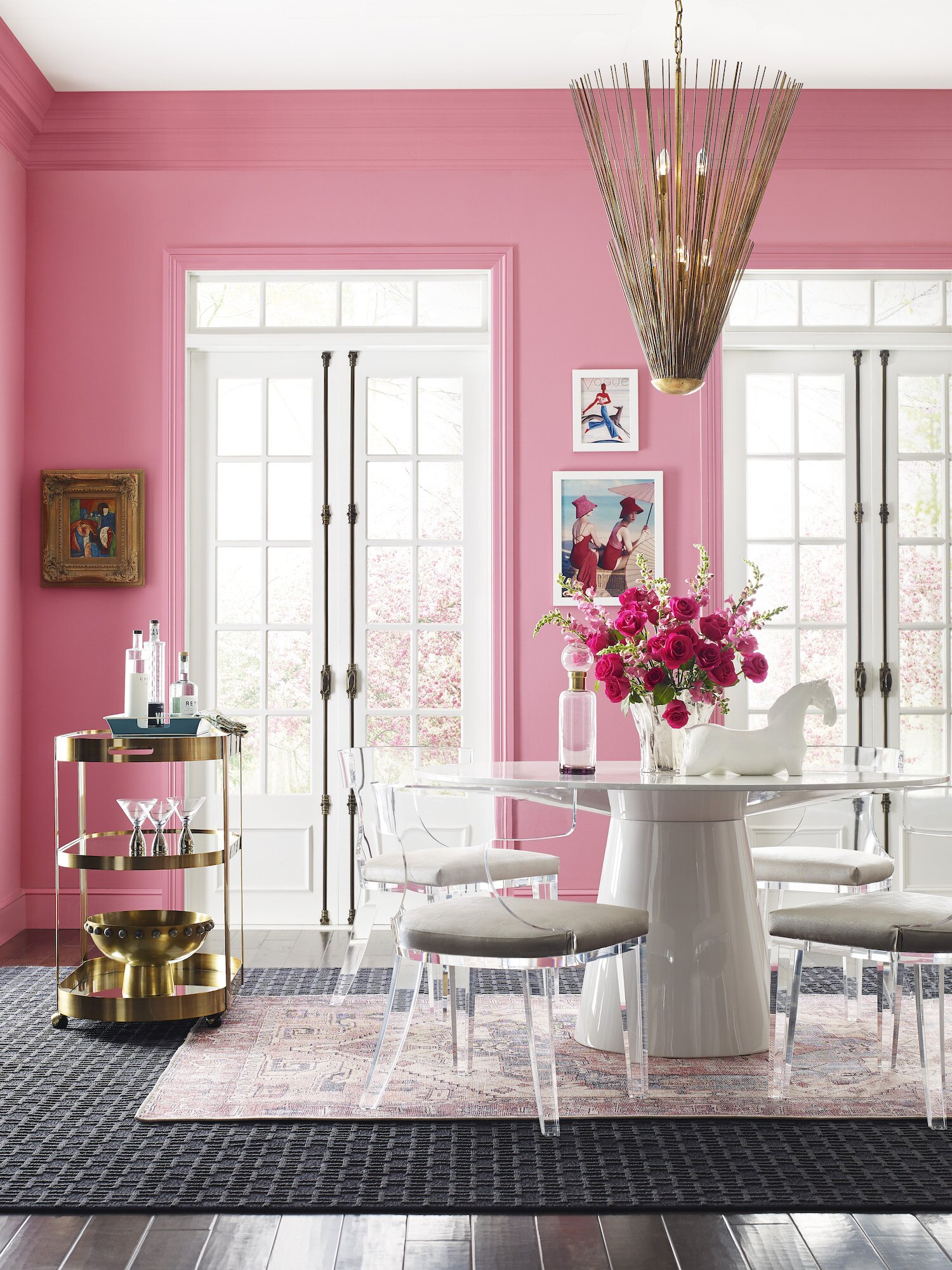 dining room with bright pink walls