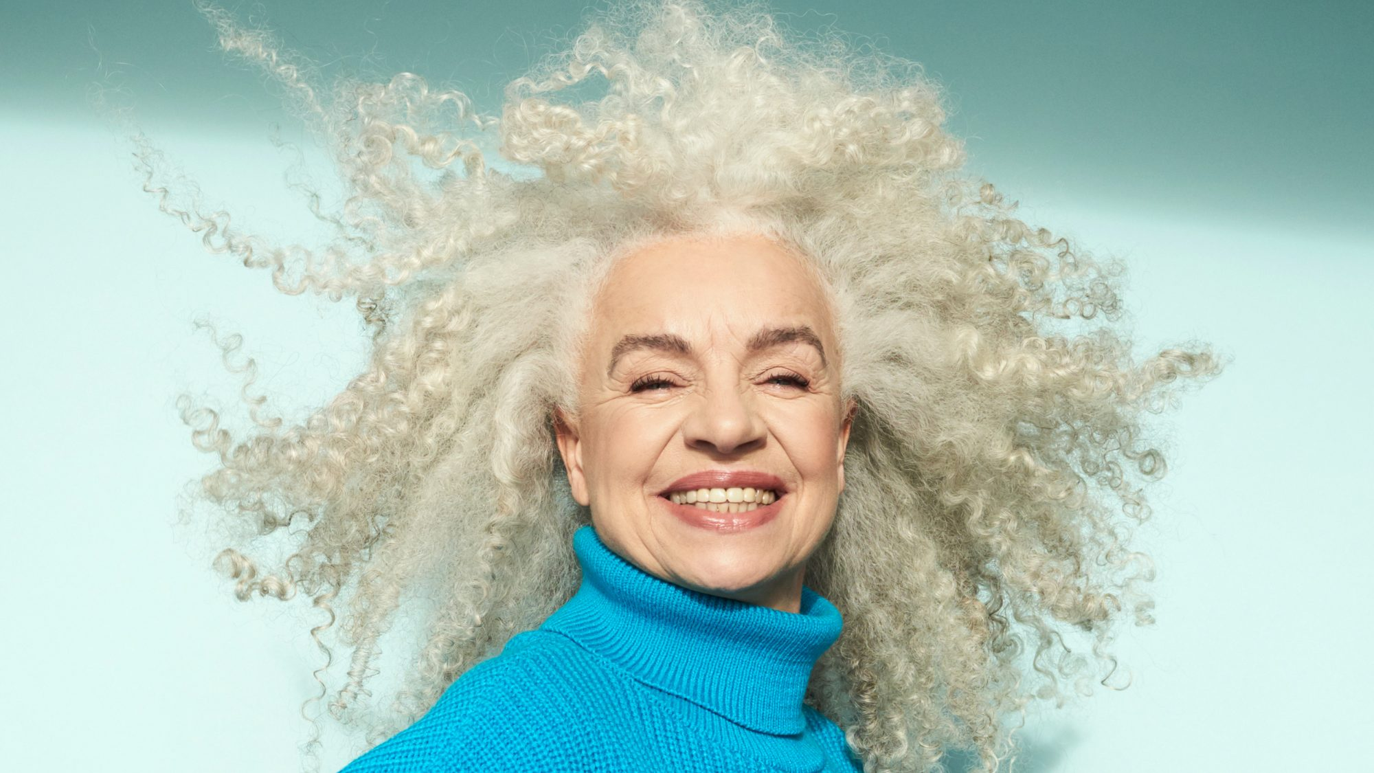 products-for-gray-hair: older woman with beautiful gray hair